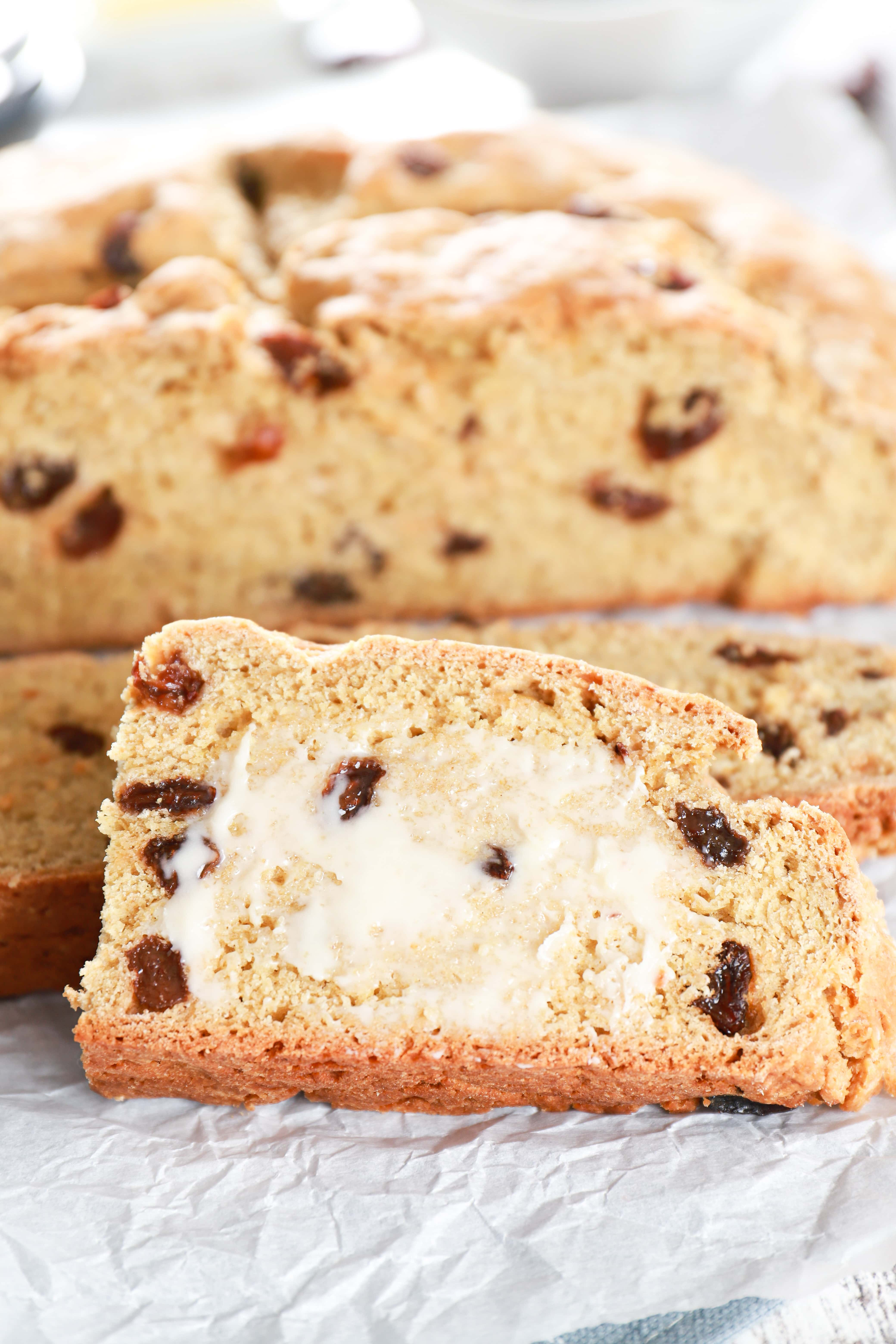 Up close image of a piece of buttered Irish Soda Bread. Recipe from A Kitchen Addiction