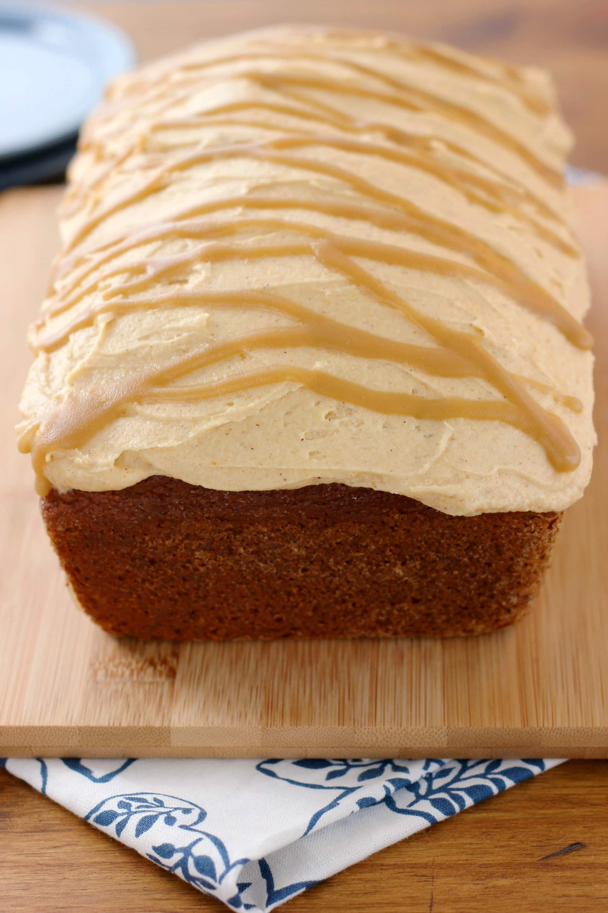 Salted Caramel Drizzled Pumpkin Buttercream Frosted Pumpkin Bread Recipe from A Kitchen Addiction