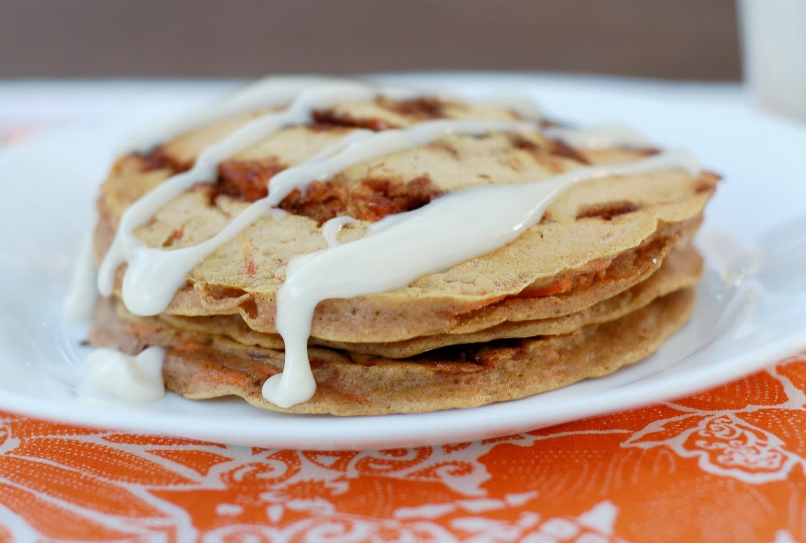 Carrot Cake Cinnamon Roll Pancakes - A Kitchen Addiction