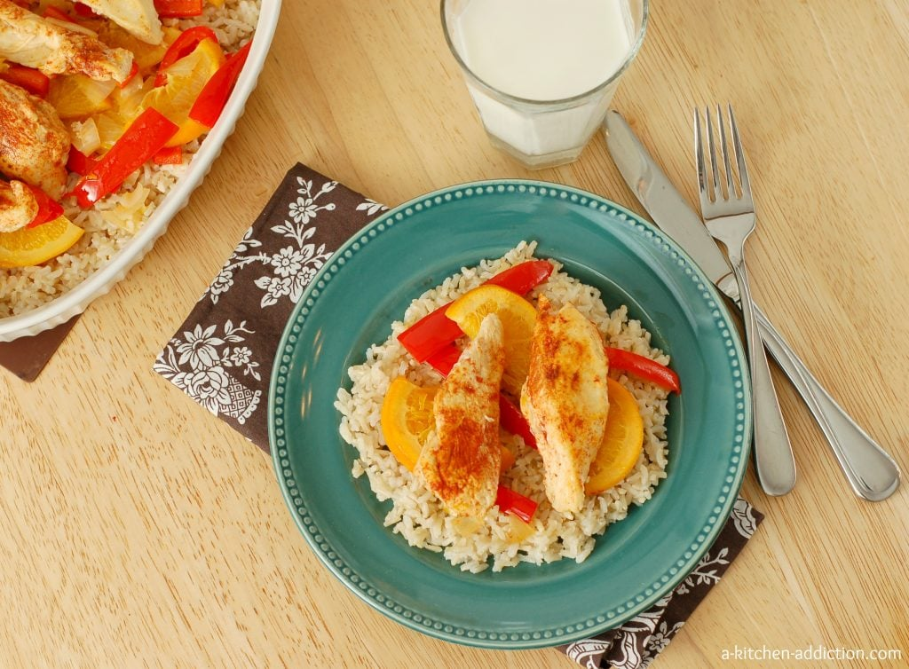 Sweet and Spicy Chicken Over Rice Recipe I www.a-kitchen-addiction.com