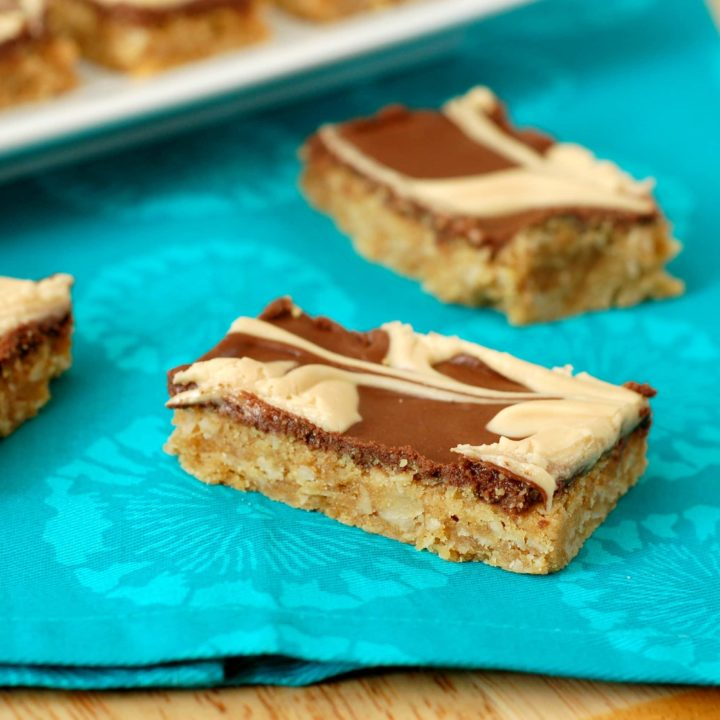 Chocolate Frosted Peanut Butter Oat Bars Recipe l www.a-kitchen-addiction.com