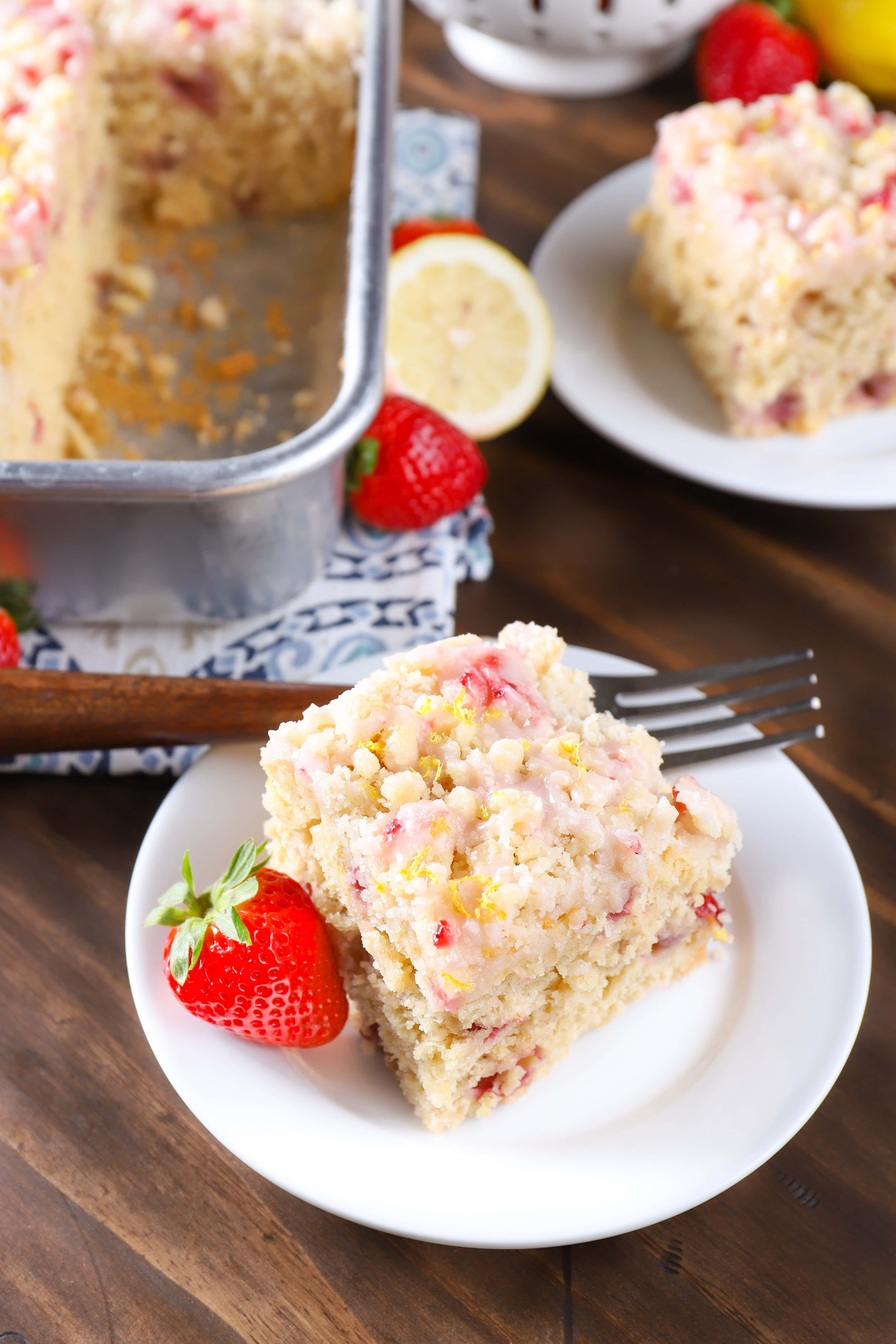Plates of Strawberry Lemon Yogurt Cake. Recipe from A Kitchen Addiction