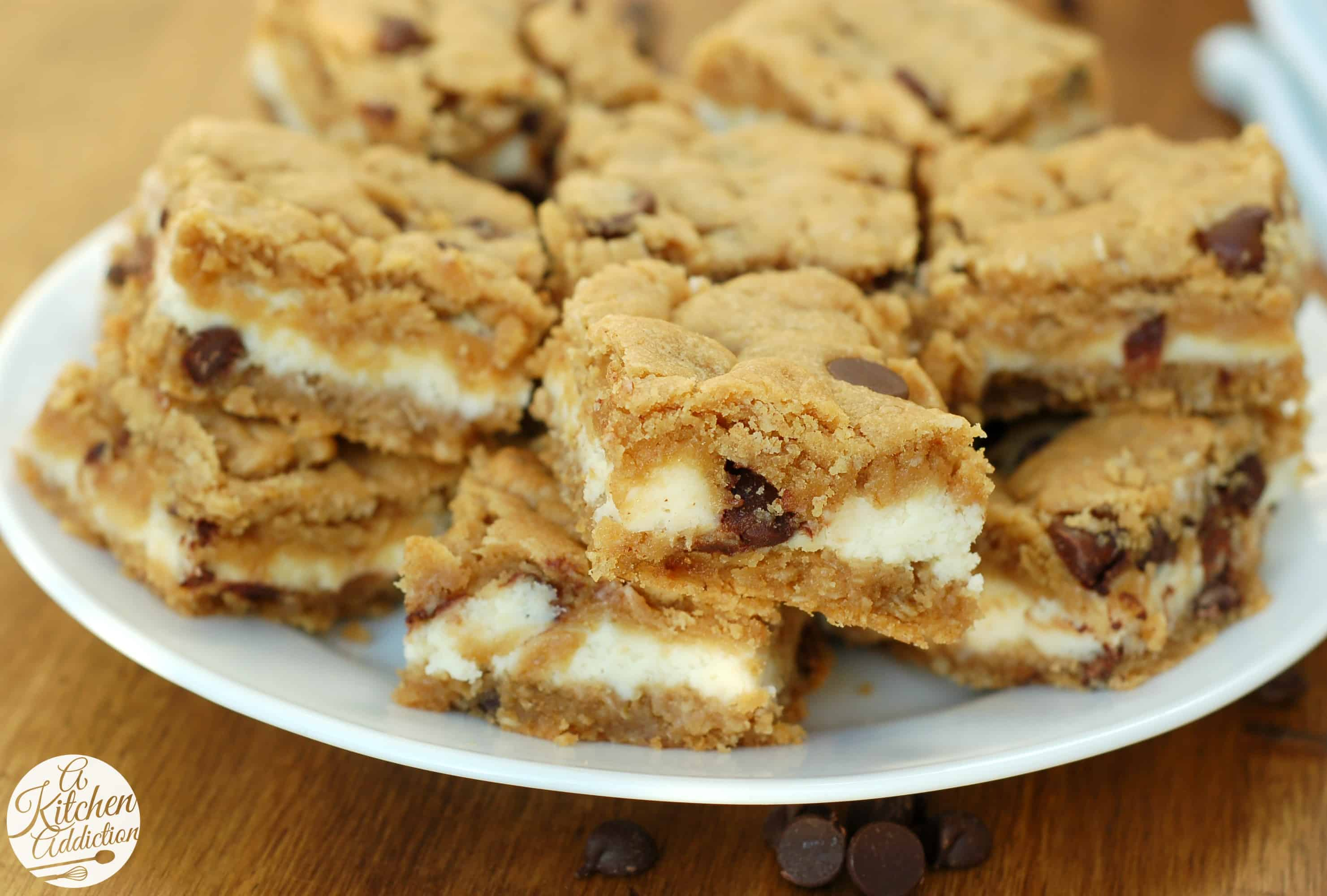 Peanut Butter Chocolate Chip Cookie Cheesecake Bars l www.a-kitchen ...