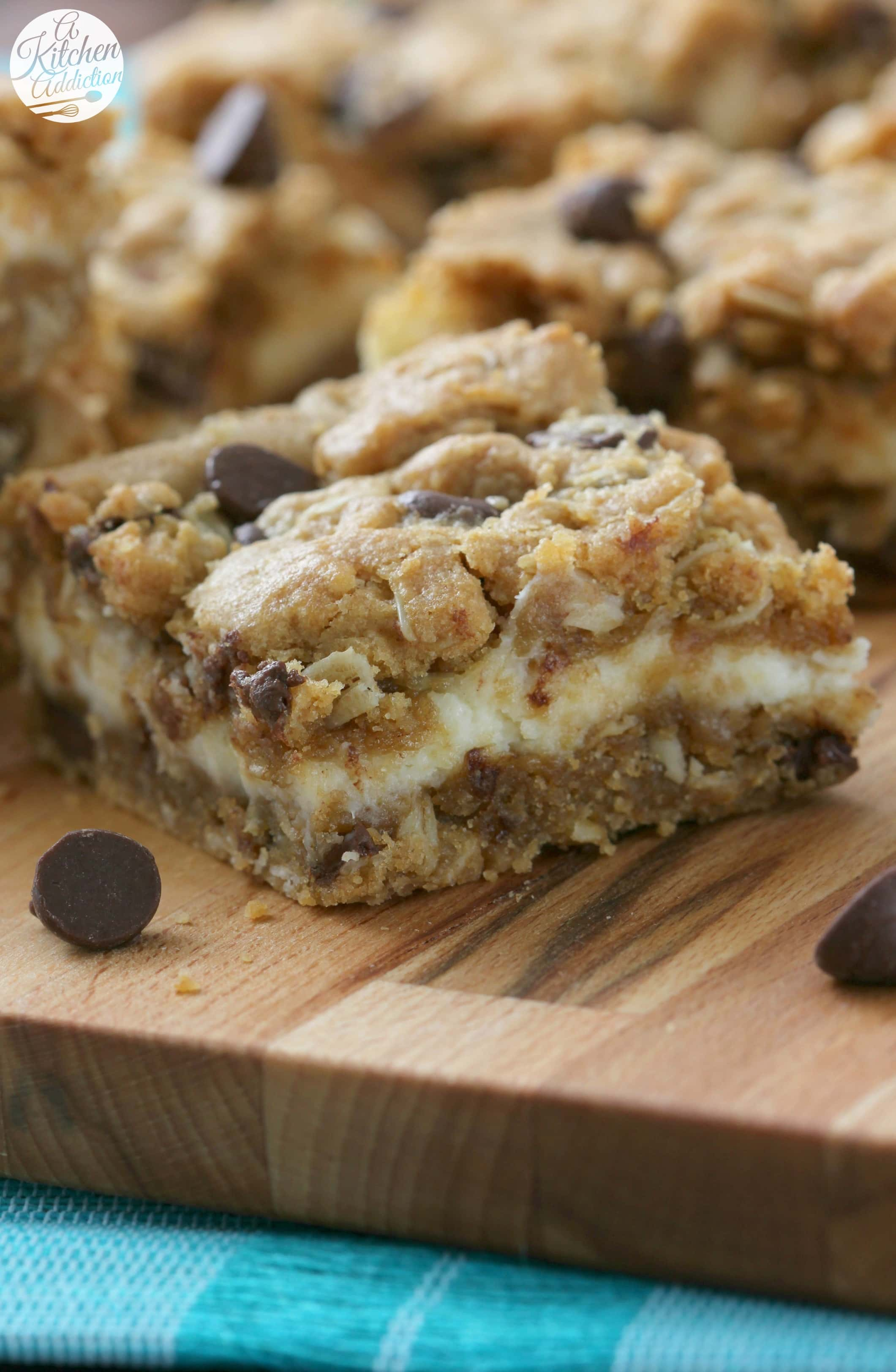 Peanut Butter Chocolate Chip Cheesecake Bars Recipe from A Kitchen Addiction