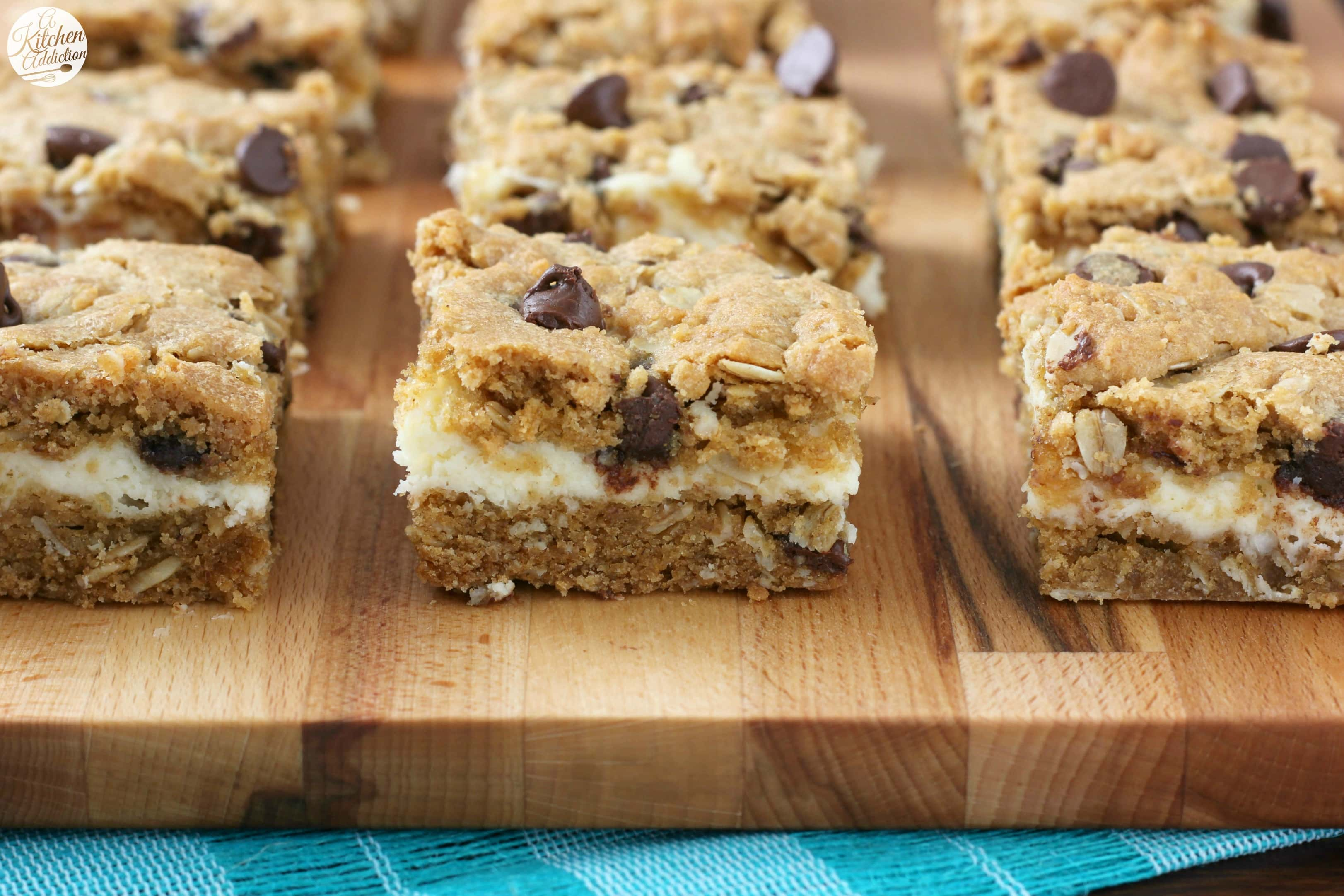 Peanut Butter Chocolate Chip Cookie Cheesecake Bars Recipe from A Kitchen Addiction