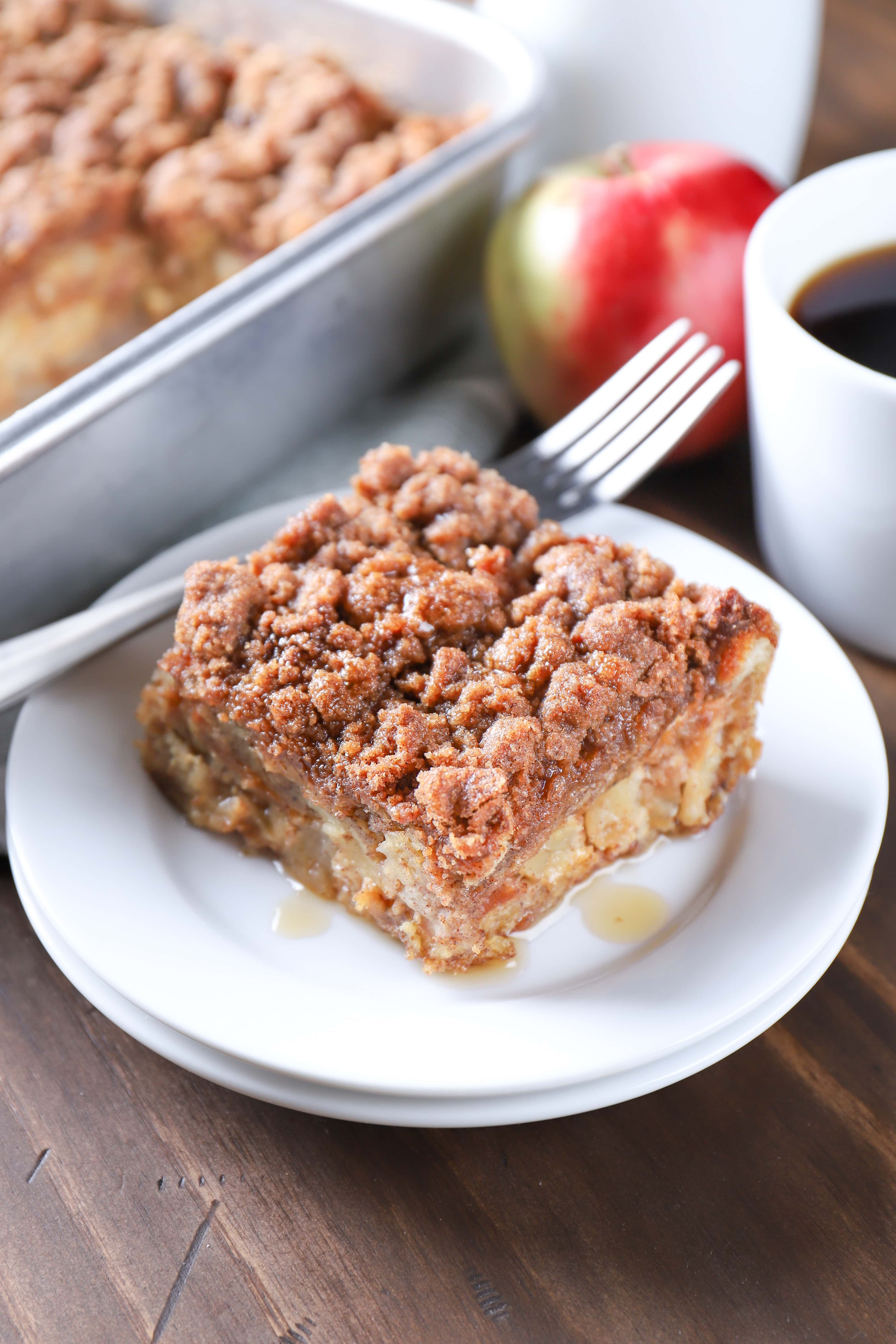 Piece of Apple Streusel French Toast Casserole with maple syrup. Recipe from A Kitchen Addiction