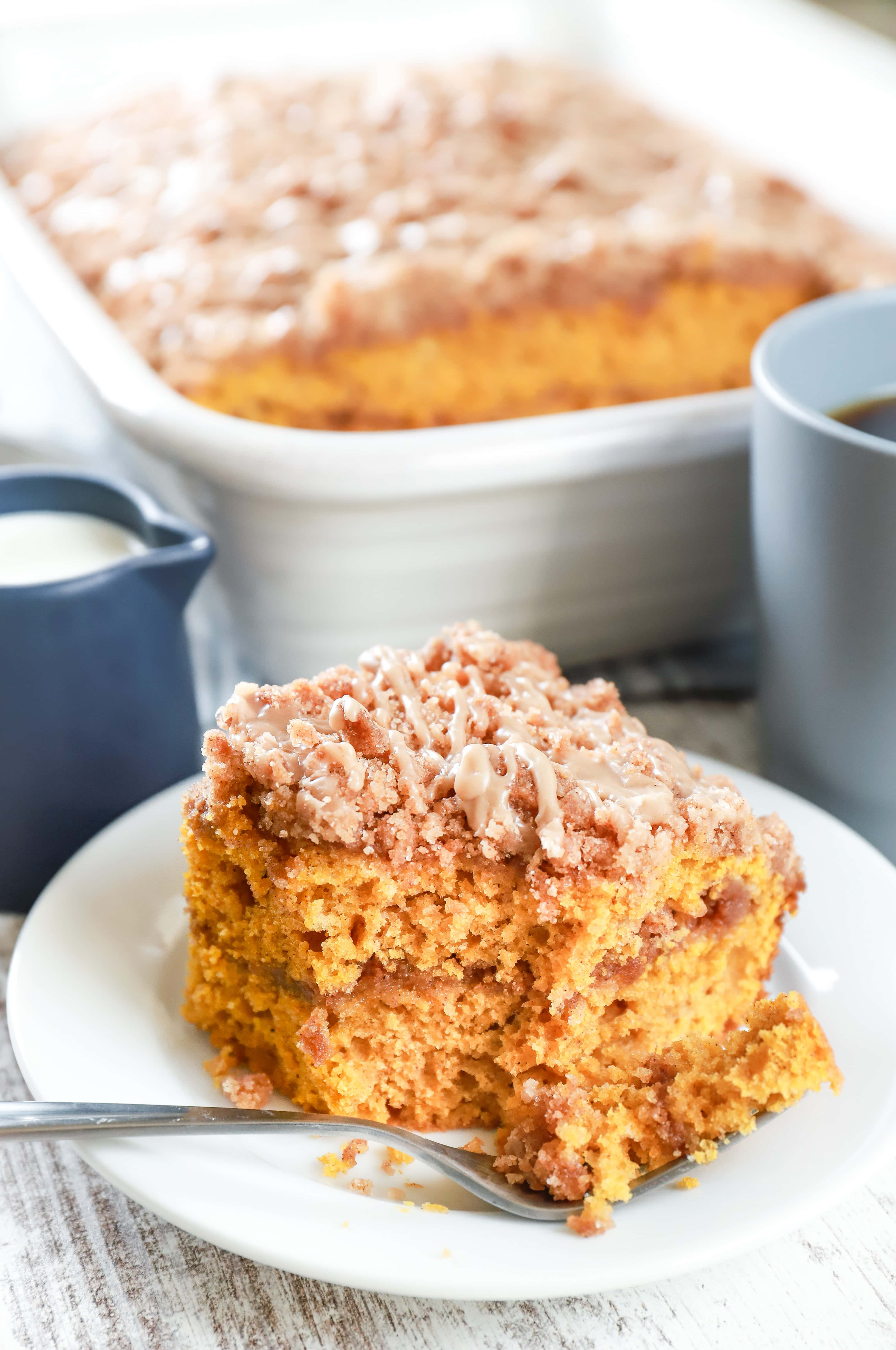 Up close image of a piece of maple cinnamon pumpkin coffee cake on a white plate. Recipe from A Kitchen Addiction