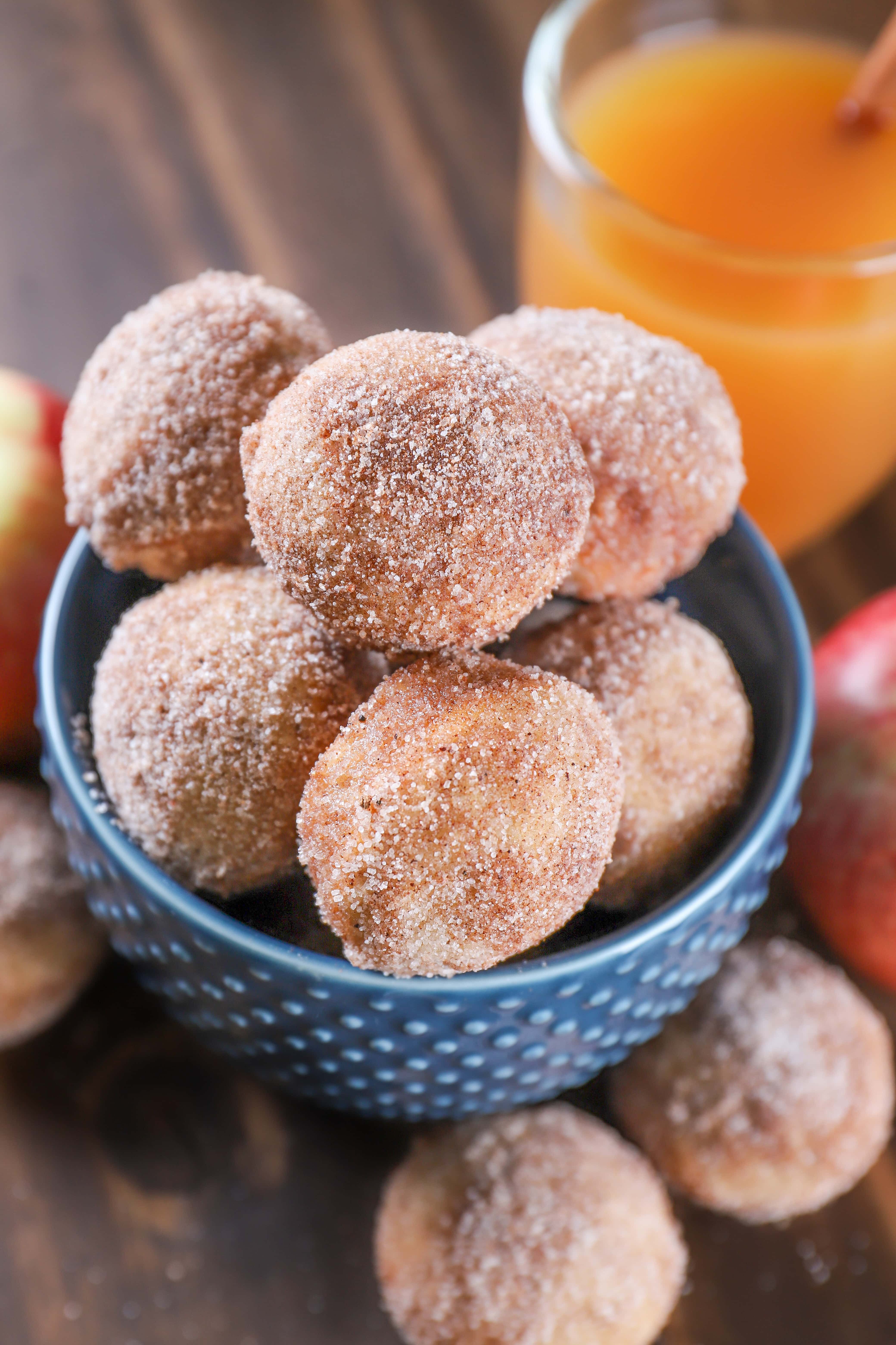 Bowl of Spiced Apple Cider Mini Donut Muffins. Recipe from A Kitchen Addiction