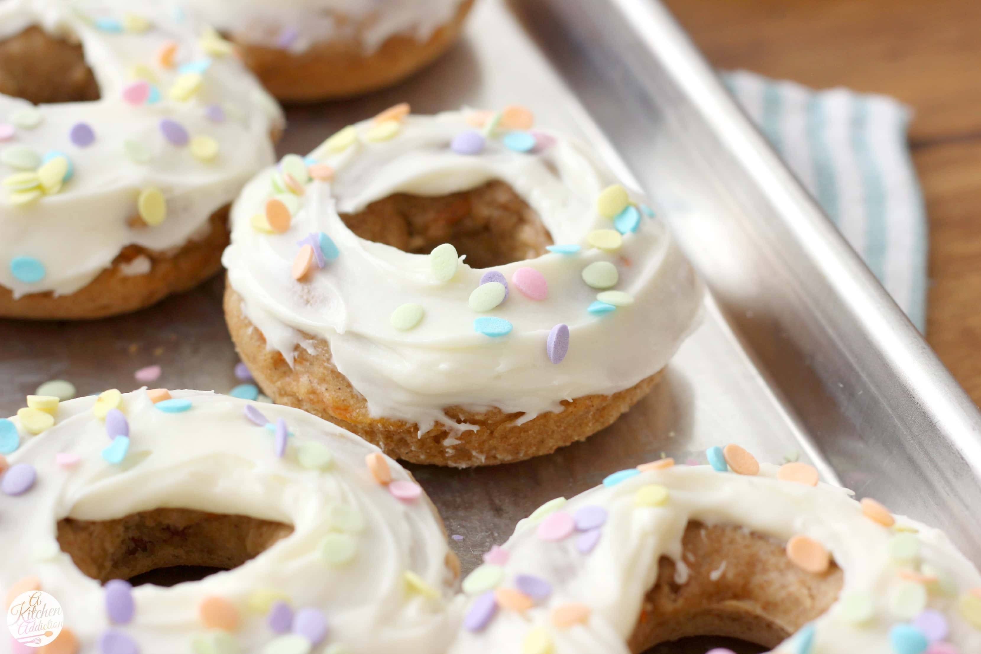 Carrot Cake Donuts with Cream Cheese Frosting Recipe l www.a-kitchen-addiction.com