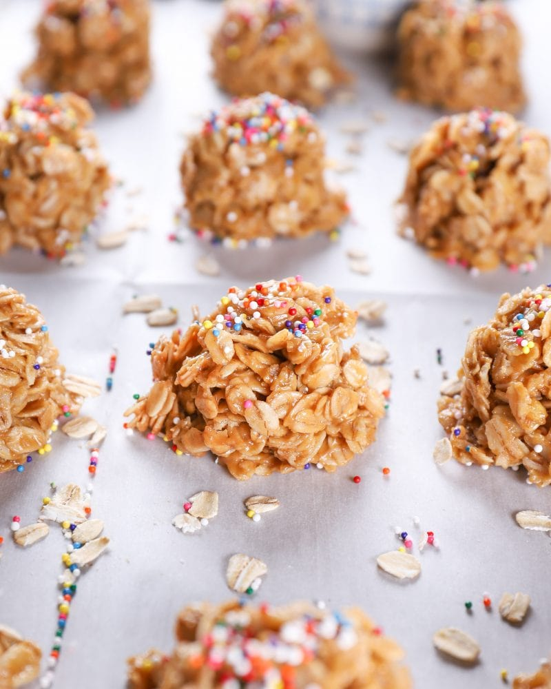 Up close image of a peanut butter honey no bake cookie on a baking sheet full of no bake cookies.