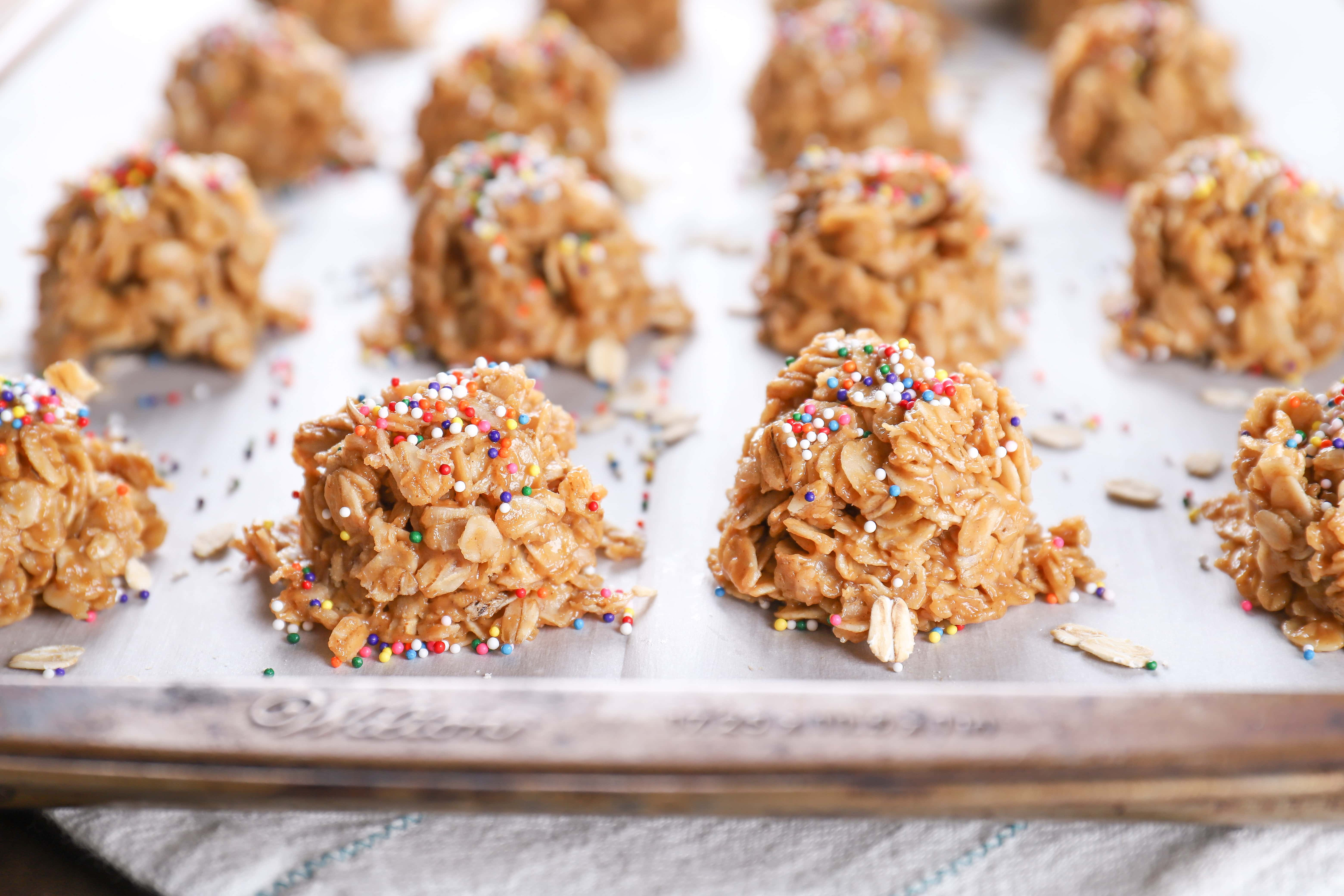Cookie sheet full of lighter peanut butter honey no bake cookies. Recipe from A Kitchen Addiction