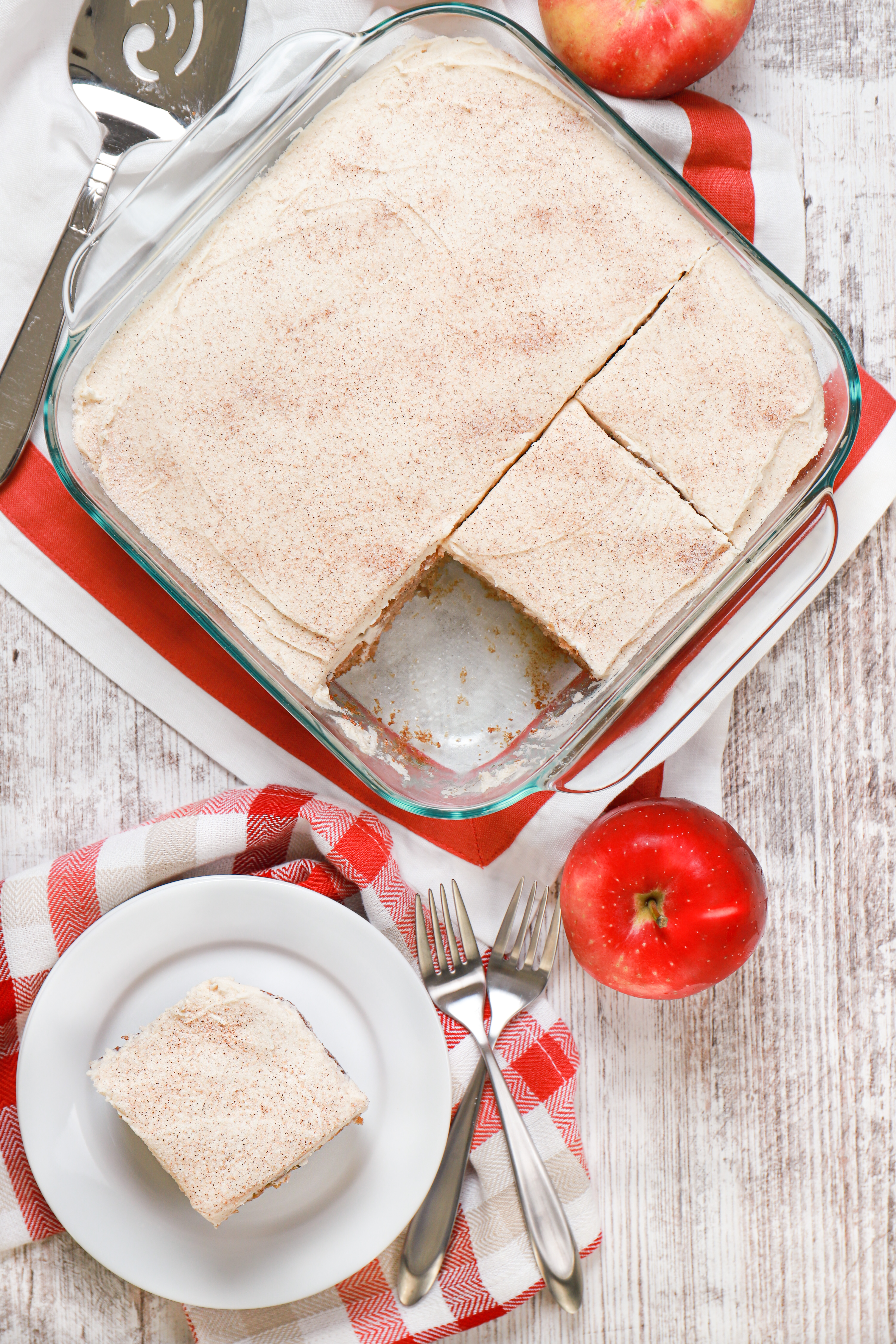 Overhead view of a apple cake with maple frosting. Recipe for cake from A Kitchen Addiction