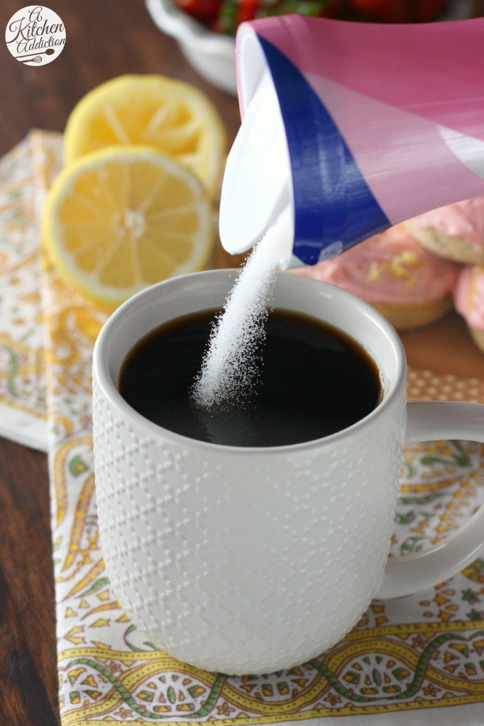Pouring Sugar in Coffee