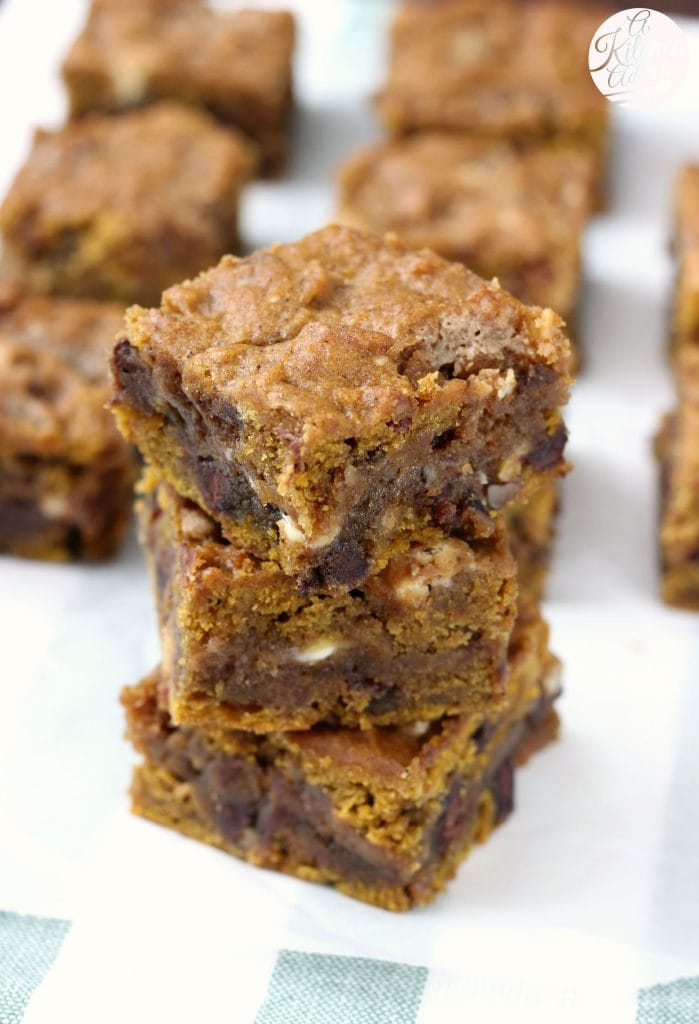Loaded Pumpkin Blondies stuffed with salted caramel, pecans, and lots of chocolate! from A Kitchen Addiction @akitchenaddict