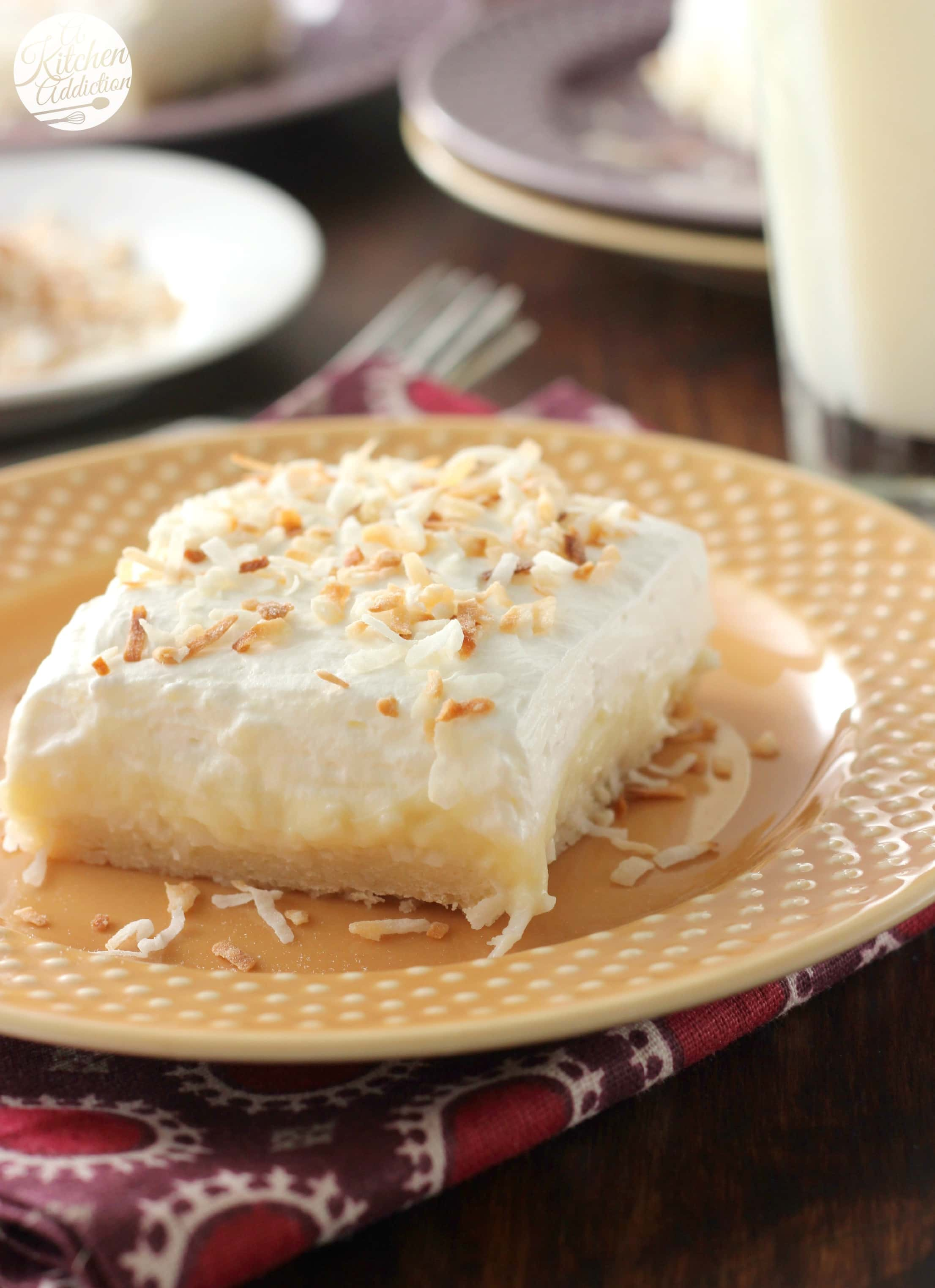 Coconut Cream Pie Bars Completely From Scratch Recipe from A Kitchen Addiction