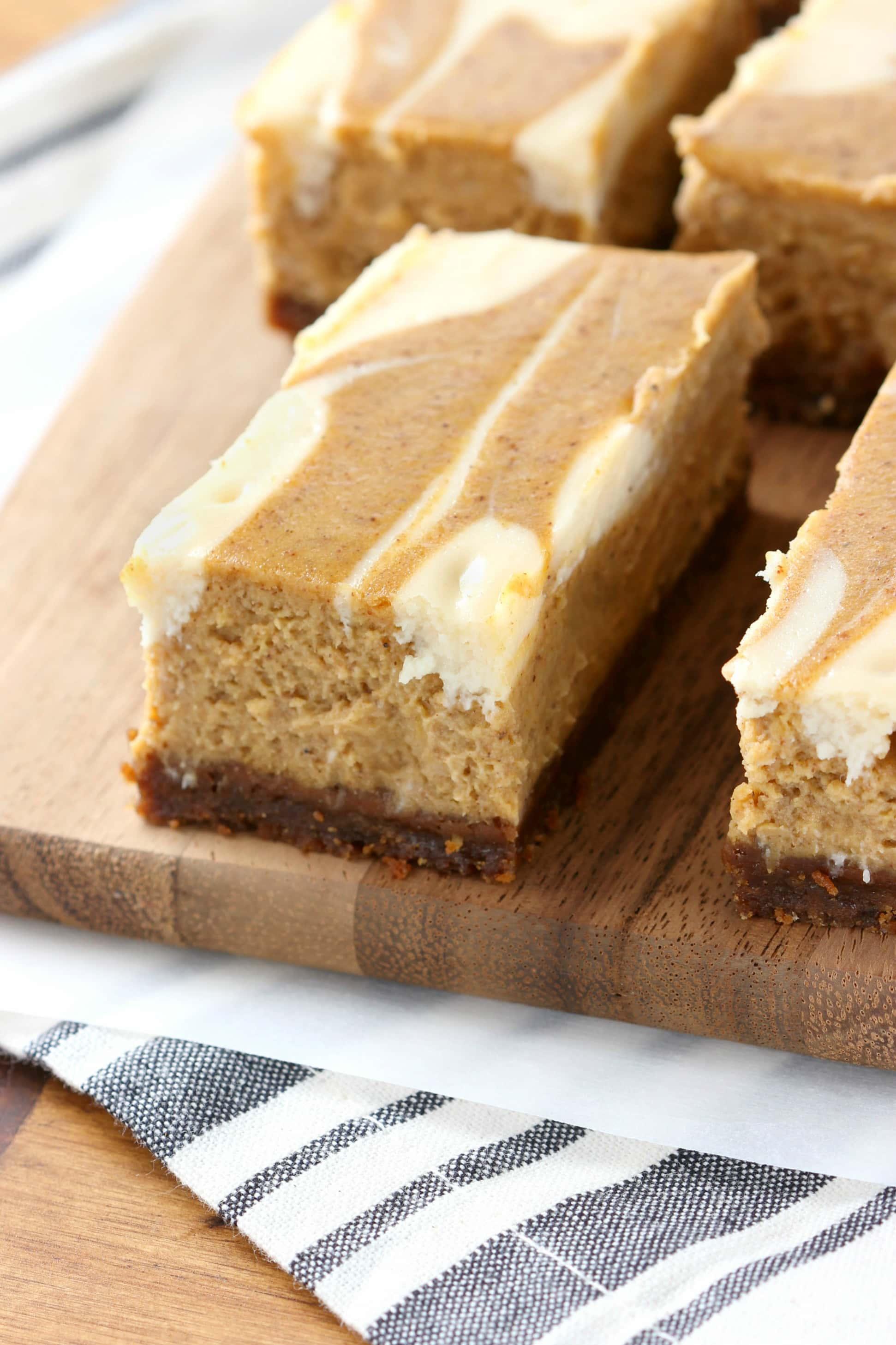 Swirled Pumpkin Pie Cheesecake Bars with Gingersnap Crust - A Kitchen ...