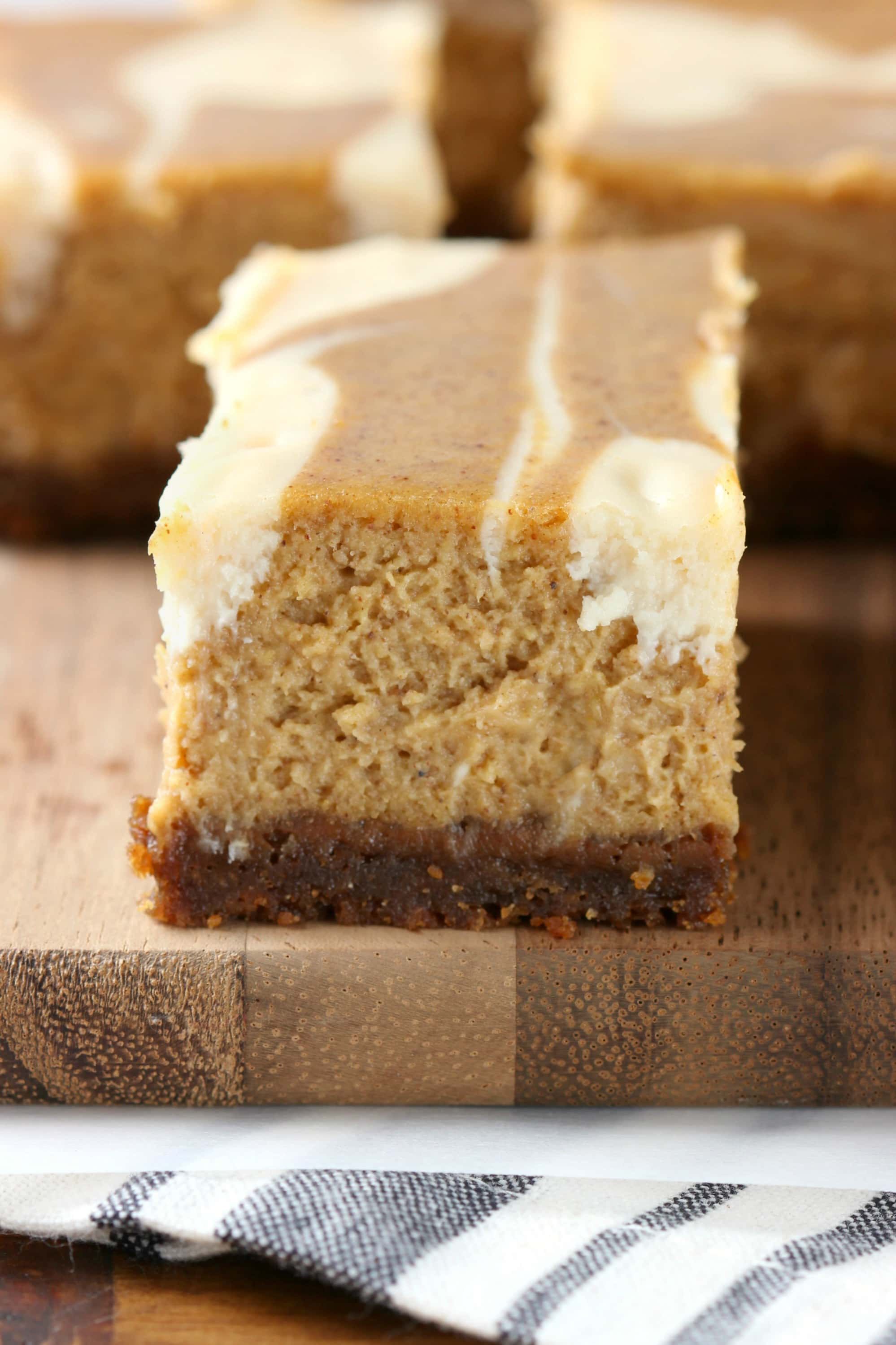 Creamy Swirled Pumpkin Cheesecake Bars with Gingersnap Crust Recipe from A Kitchen Addiction
