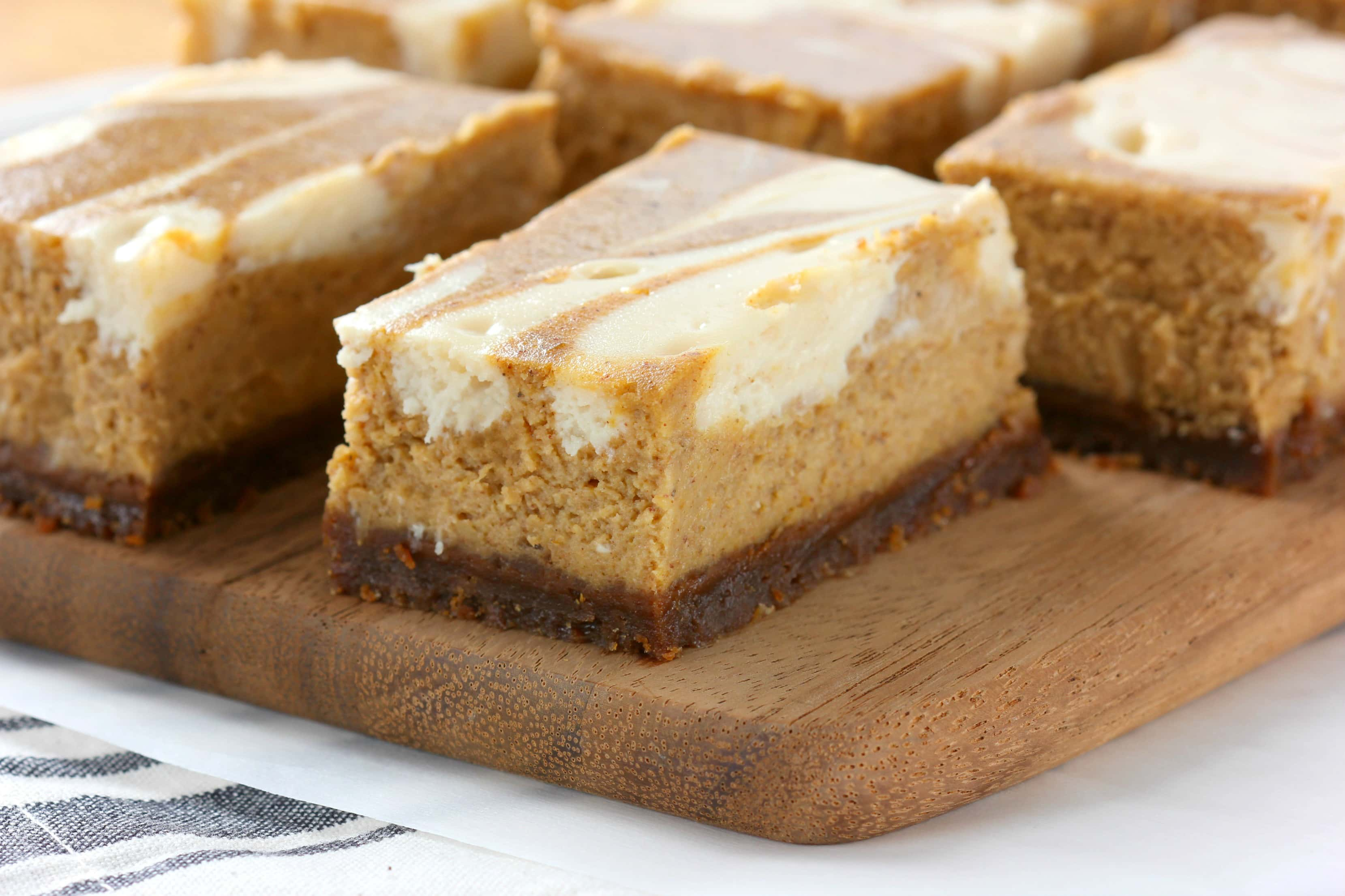 Swirled Pumpkin Cheesecake Bars with Gingersnap Crust Recipe from A Kitchen Addiction