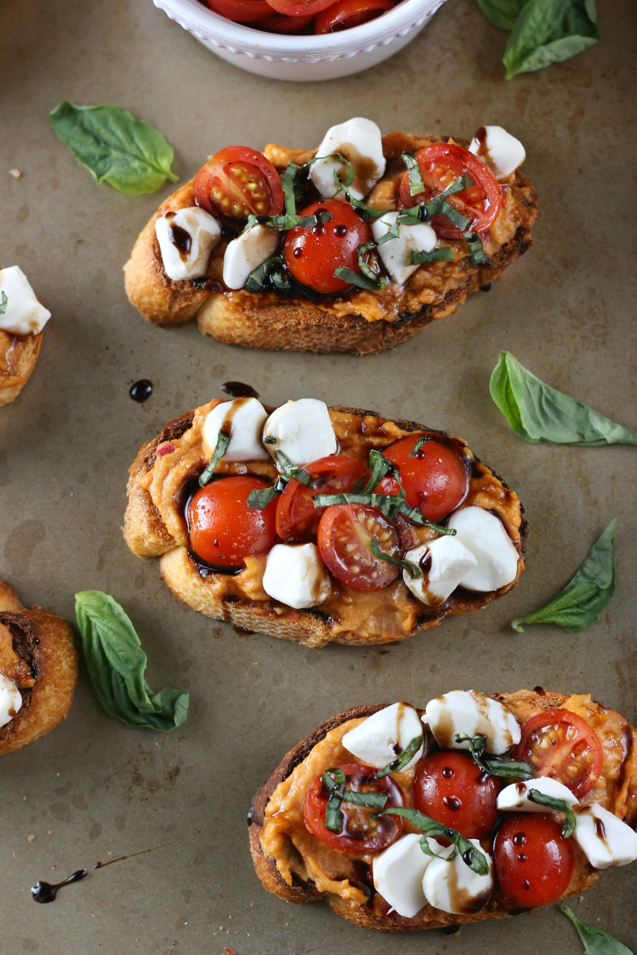 Caprese Roasted Red Pepper Hummus Crostini Recipe from A Kitchen Addiction