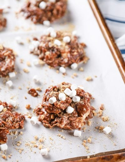 Easy Smores No Bake Cookies on a parchment paper lined baking sheet. Recipe from A Kitchen Addiction