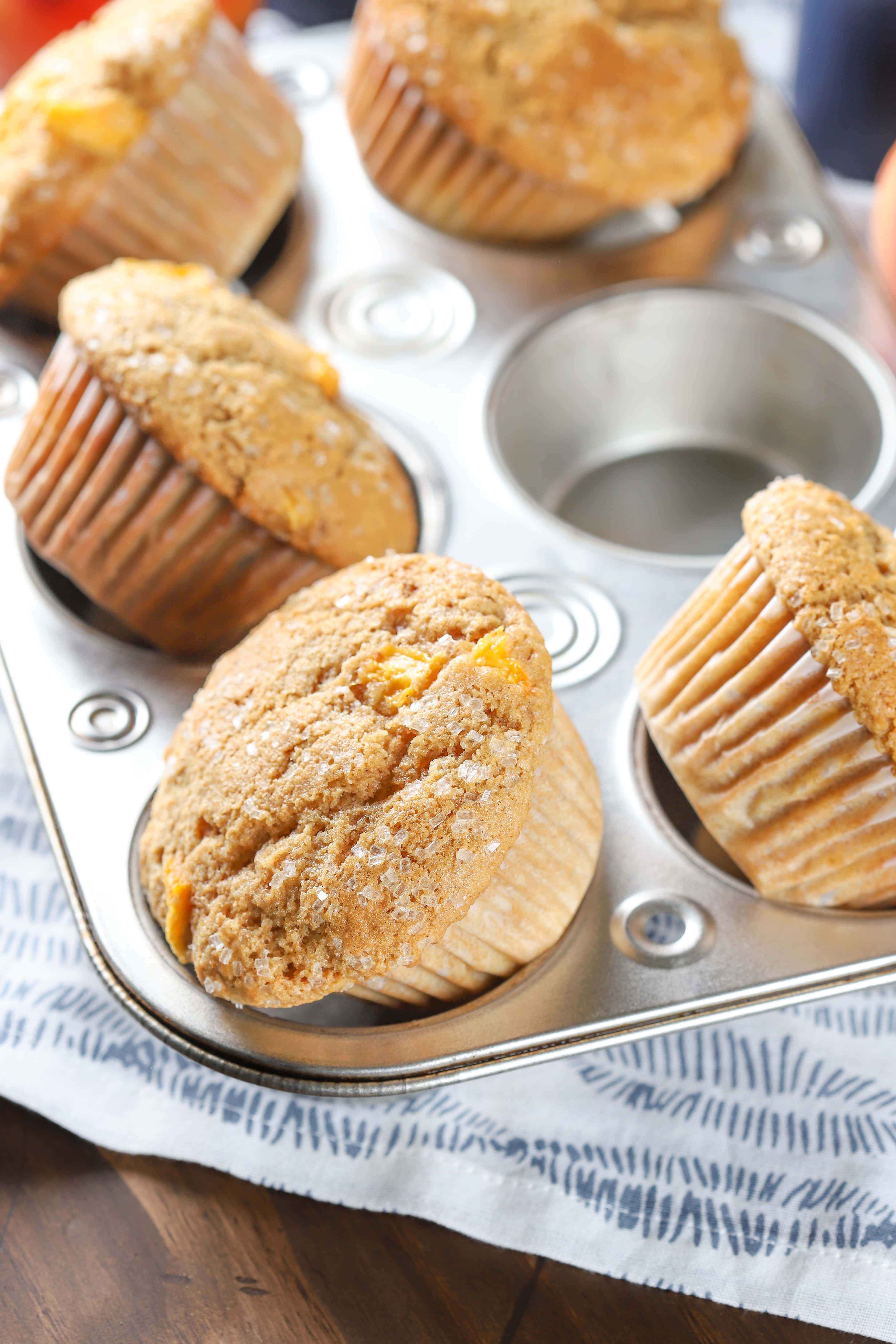Bakery Style Peach Cardamom Muffins in a muffin tin. Recipe from A Kitchen Addiction
