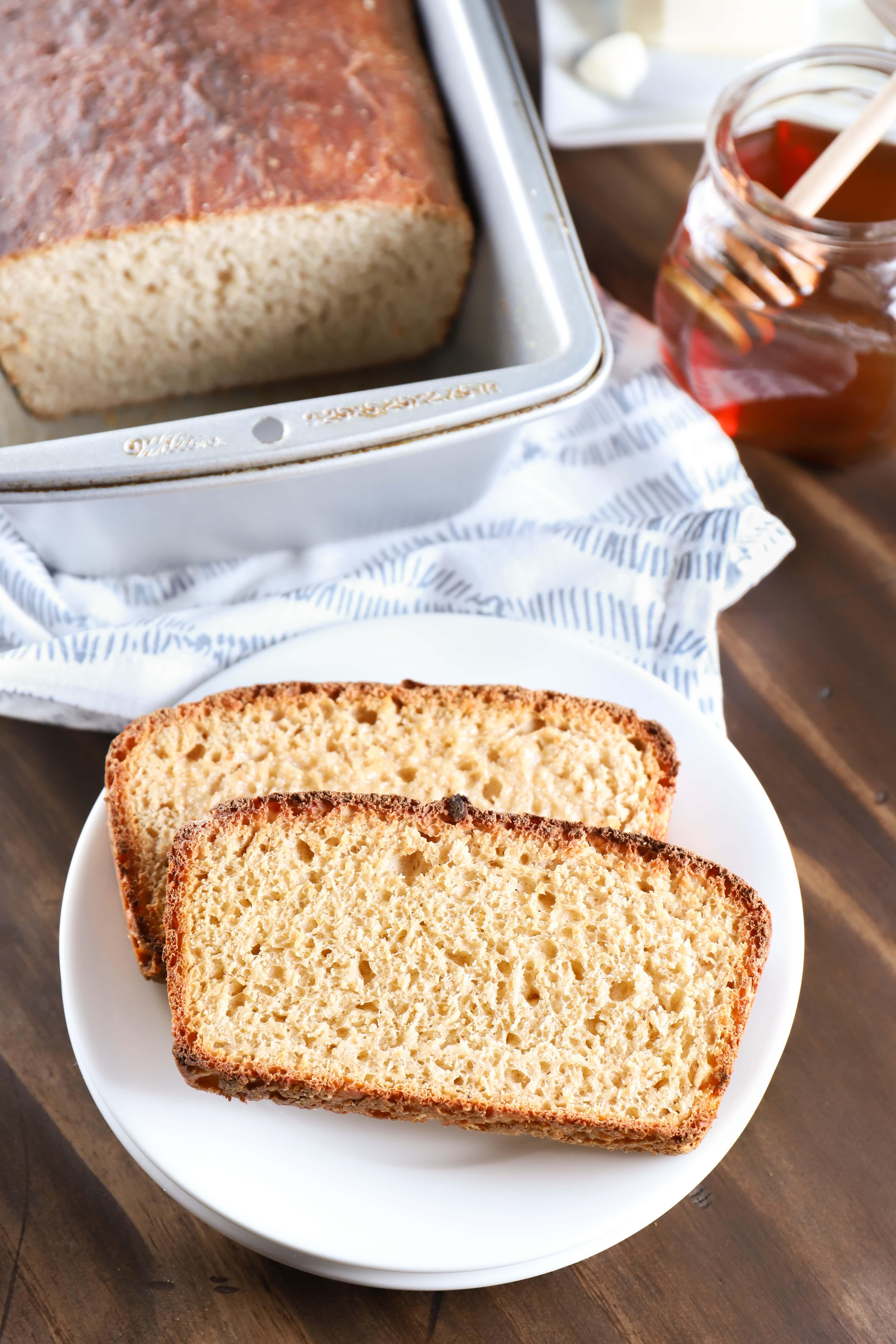 Toasted Sourdough English Muffin Bread on a plate. Recipe for bread from A Kitchen Addiction