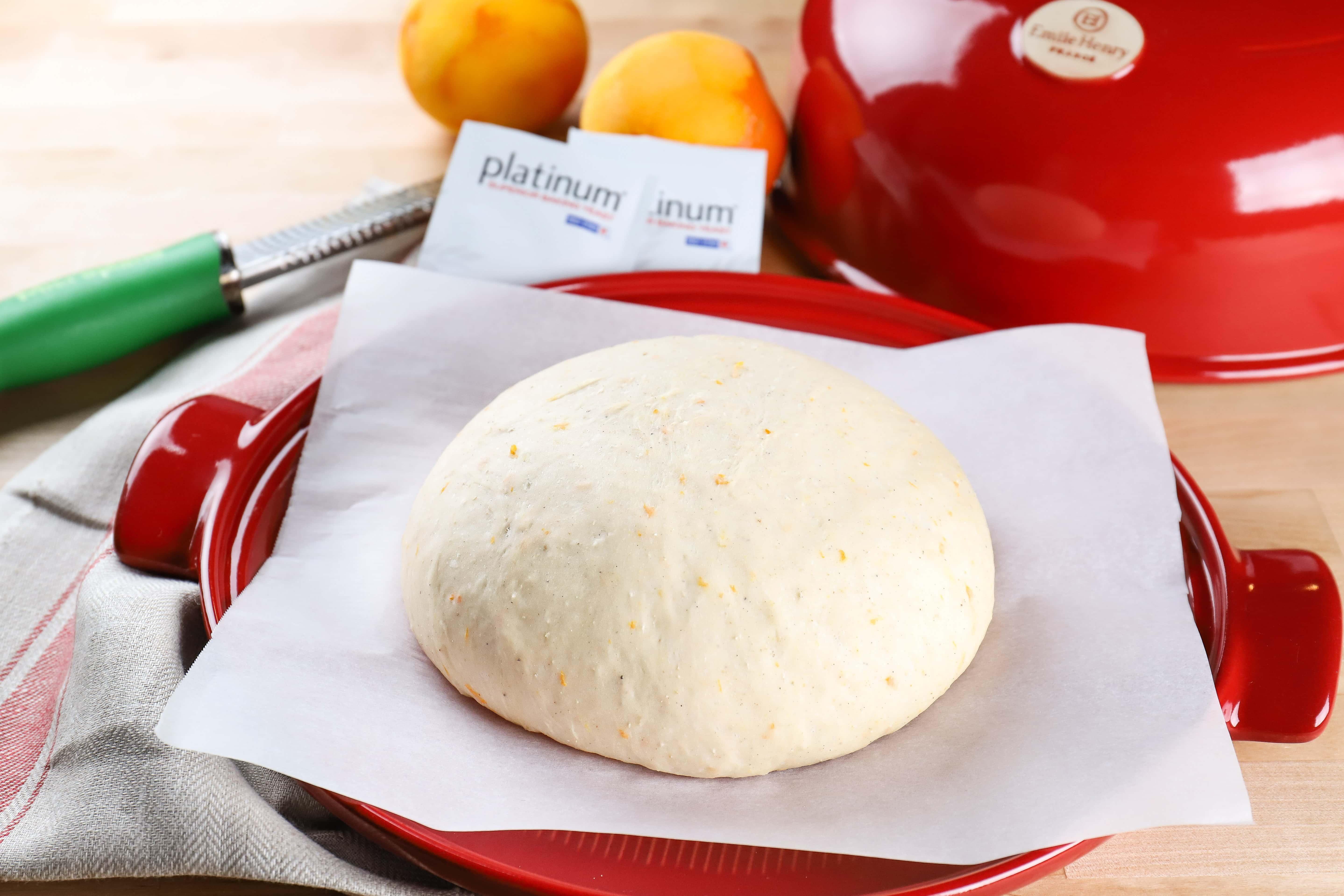 orange cardamom bread dough on emile henry bread cloche