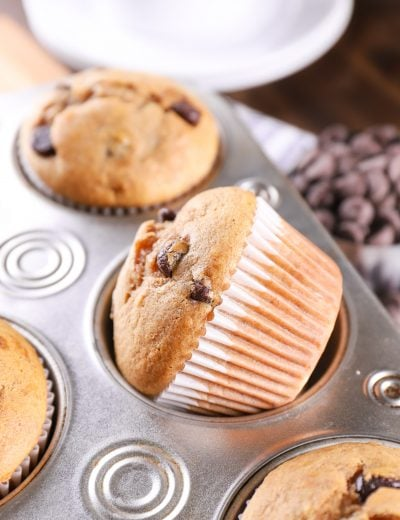 Chocolate Chip Almond Butter Protein Muffin in a muffin tin. Recipe for protein muffins from A Kitchen Addiction