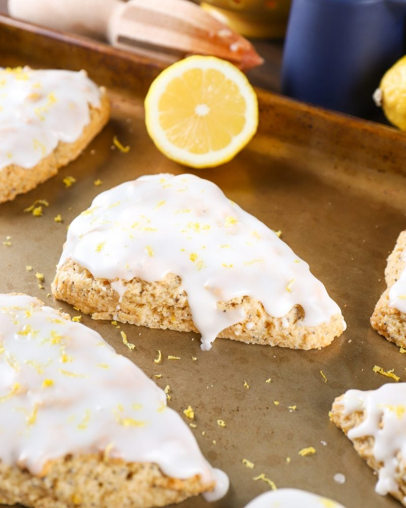 Baking sheet with Lemon Poppy Seed Scones. Recipe from A Kitchen Addiction