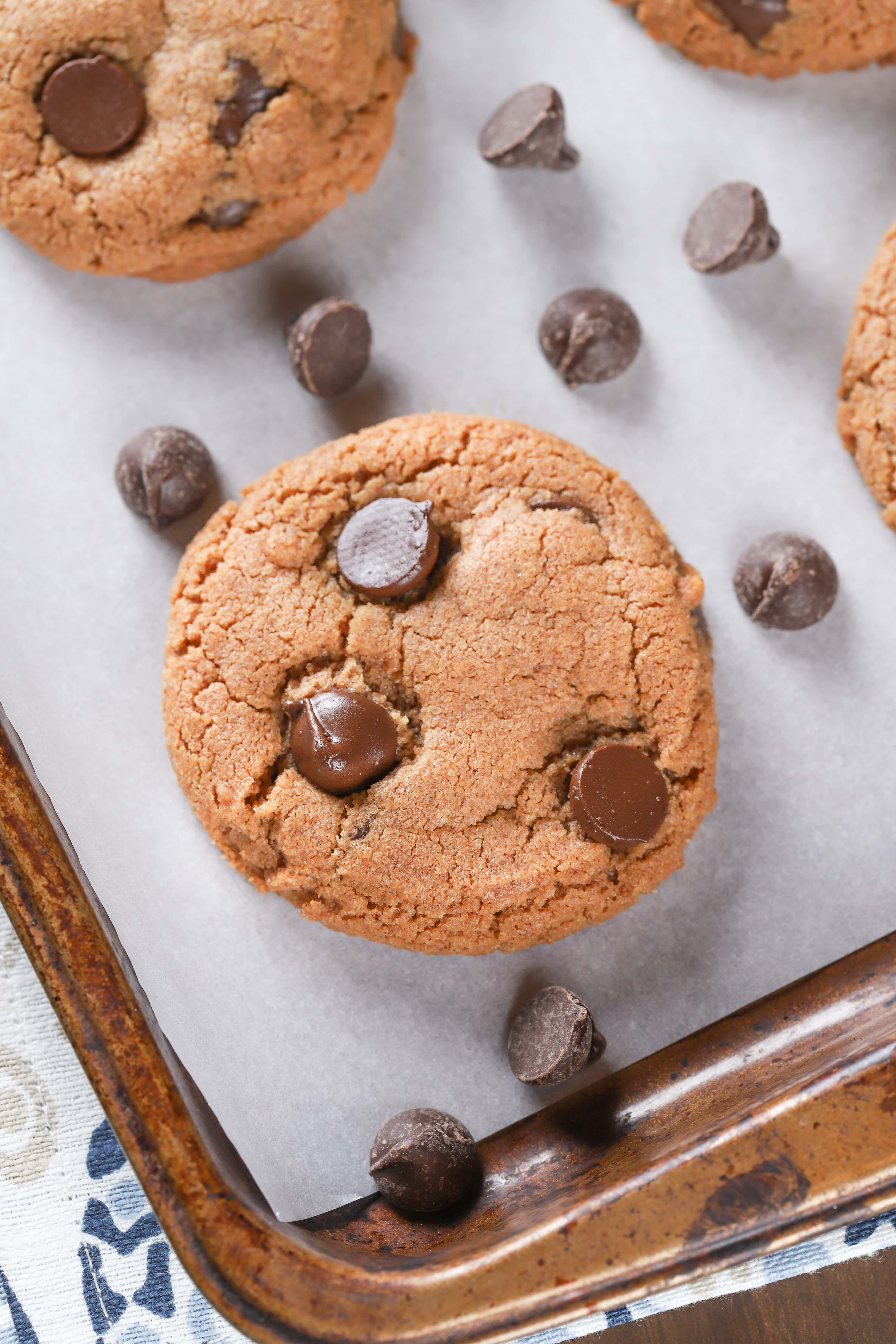 Up close image of a flourless almond butter chocolate chip cookie. Recipe from A Kitchen Addiction