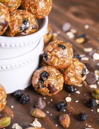 Up close image of a stack of dark chocolate blueberry pistachio granola bites.