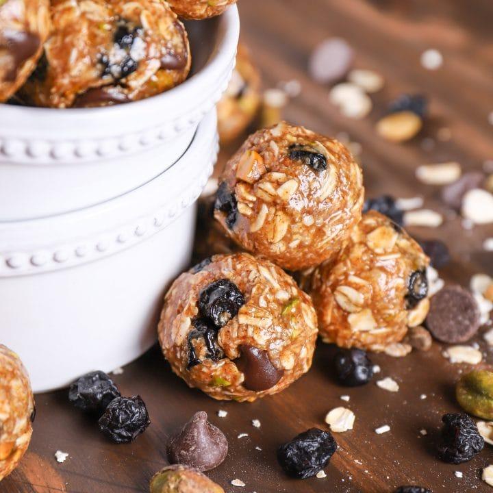Up close image of a stack of dark chocolate blueberry pistachio granola bites.