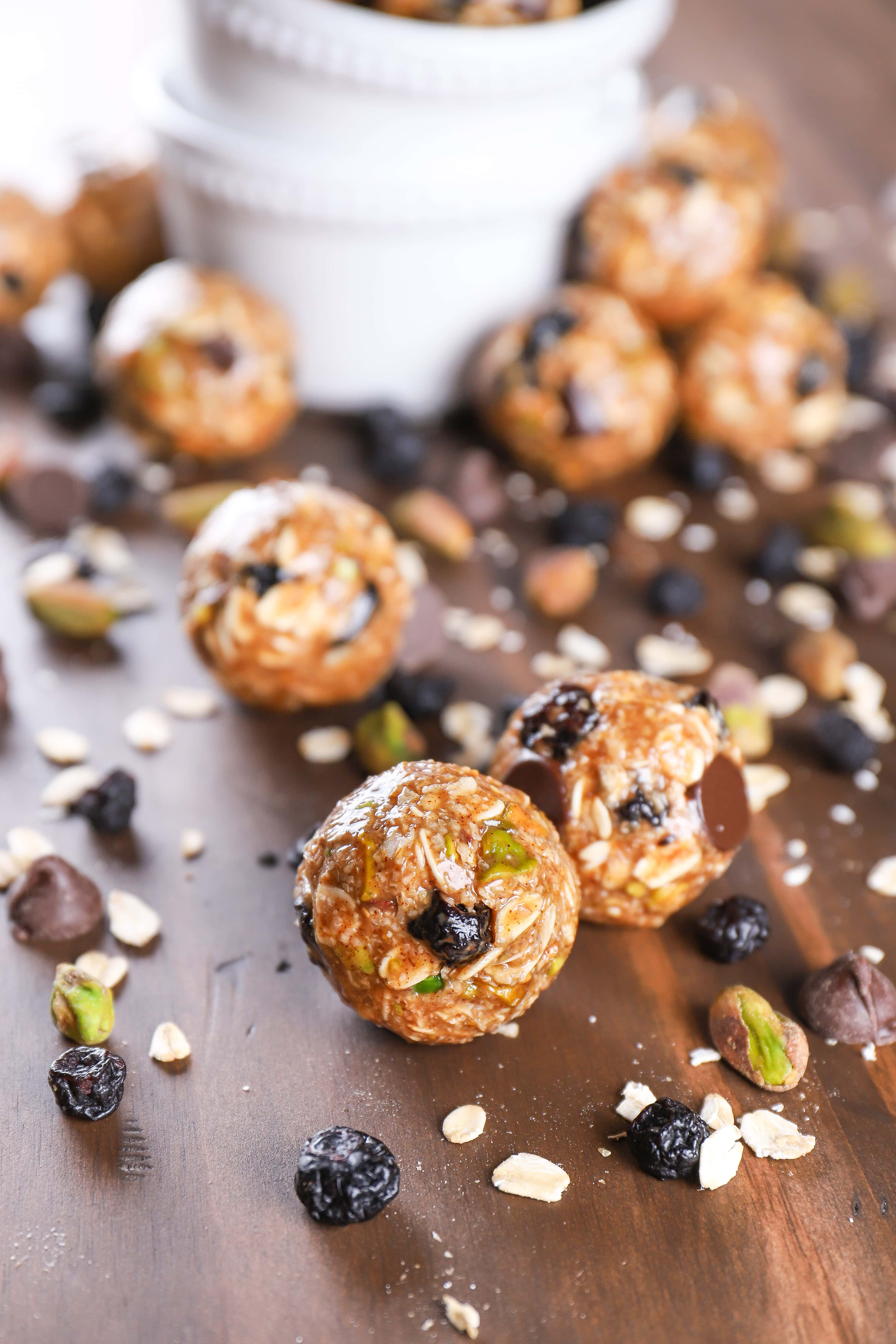 a handful of dark chocolate blueberry pistachio granola bites on a table