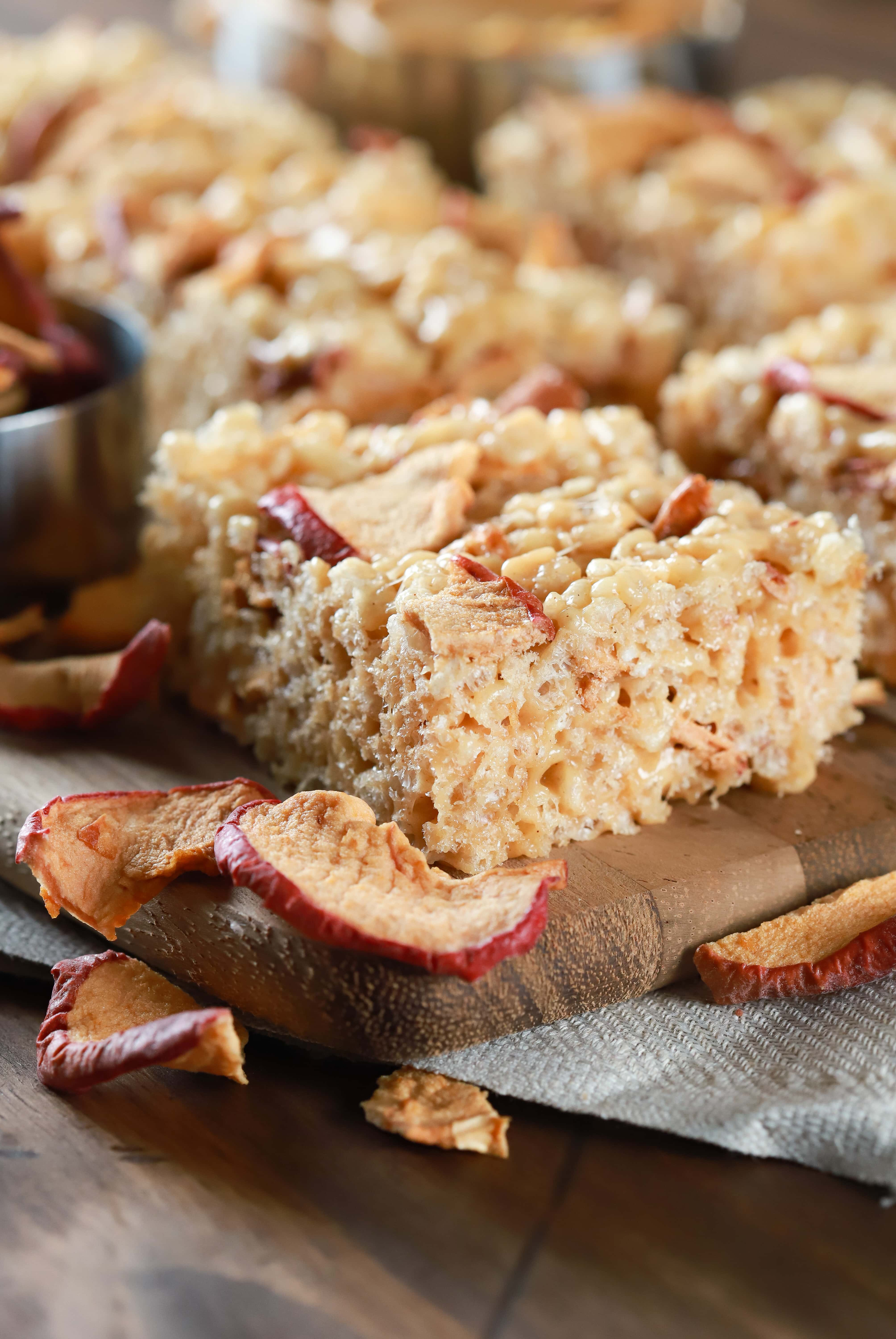 Easy apple peanut butter rice crispy treats on a cutting board. Recipe from A Kitchen Addiction