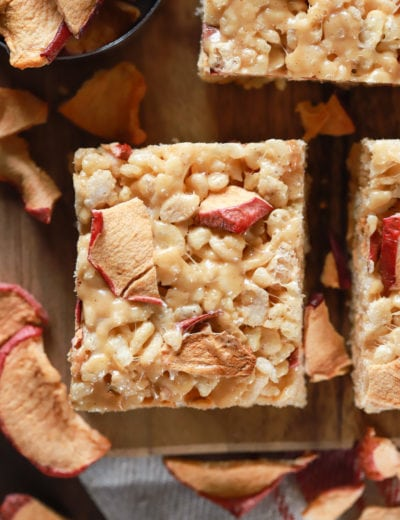Up close overhead view of an apple peanut butter rice crispy treat on a cutting board. Recipe from A Kitchen Addiction