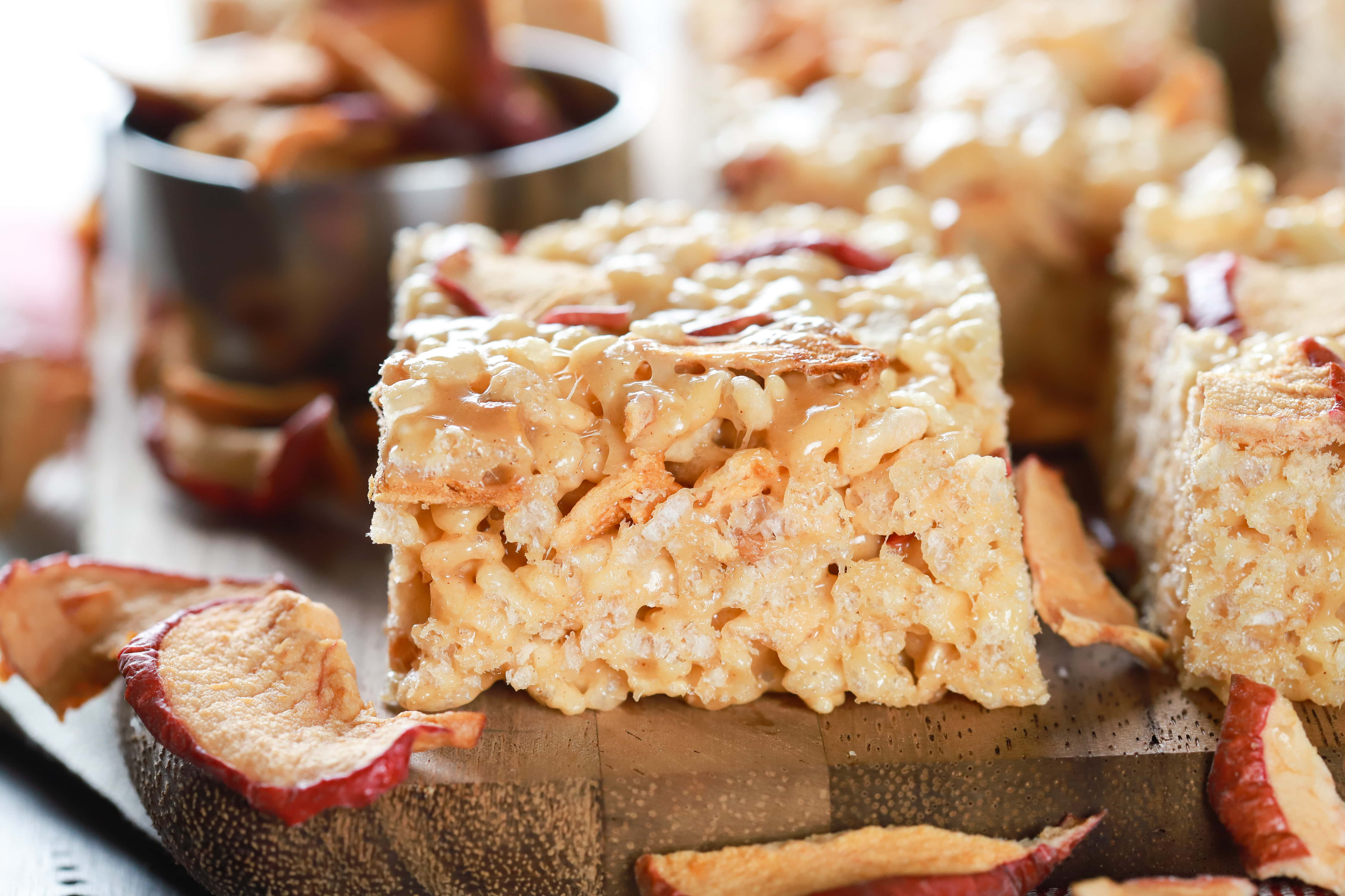 Up close side view of an apple peanut butter rice crispy treat on a cutting board. Recipe from A Kitchen Addiction