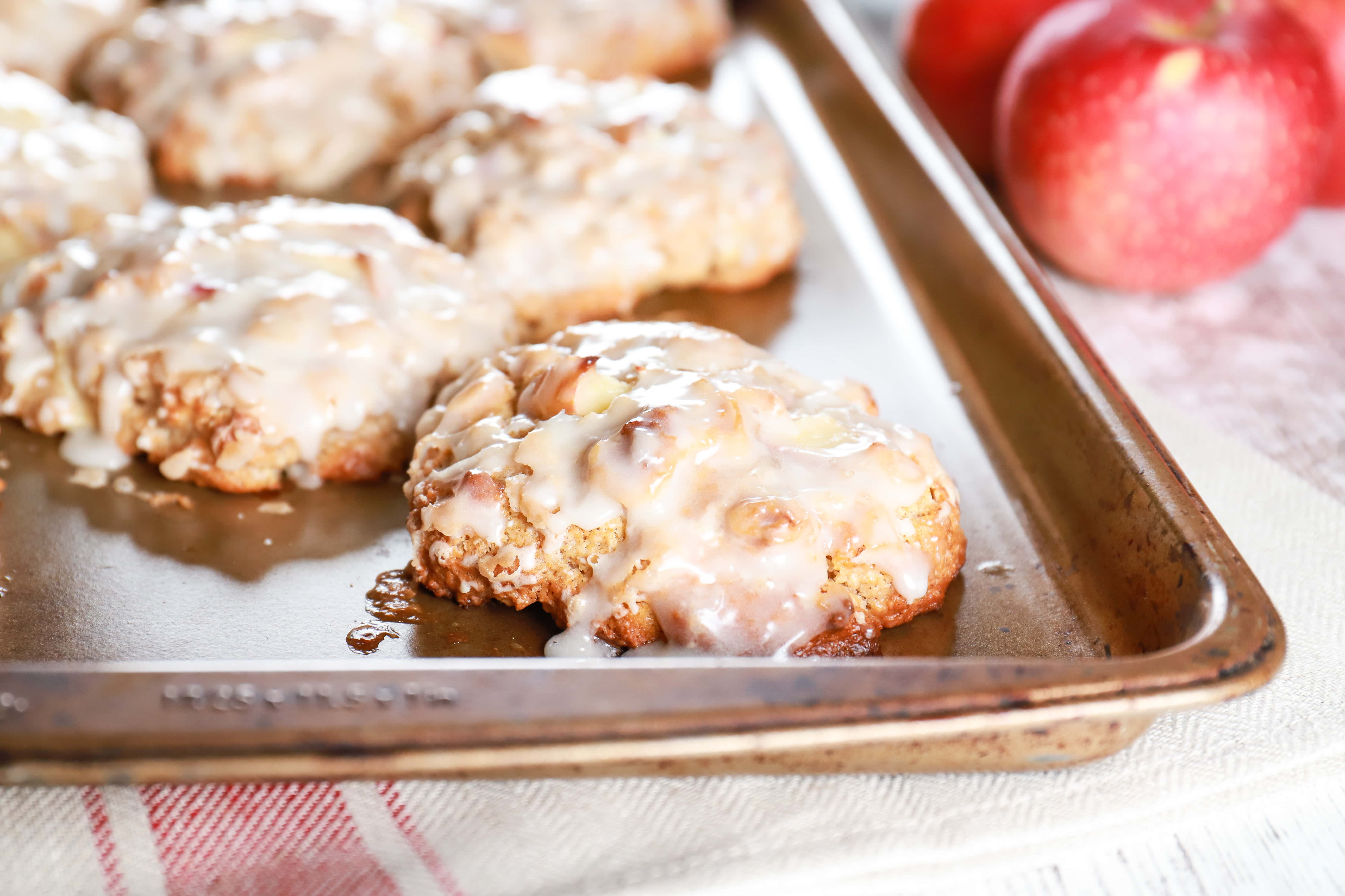 Up close image of a baked apple fritter on a cookie sheet. Recipe from A Kitchen Addiction