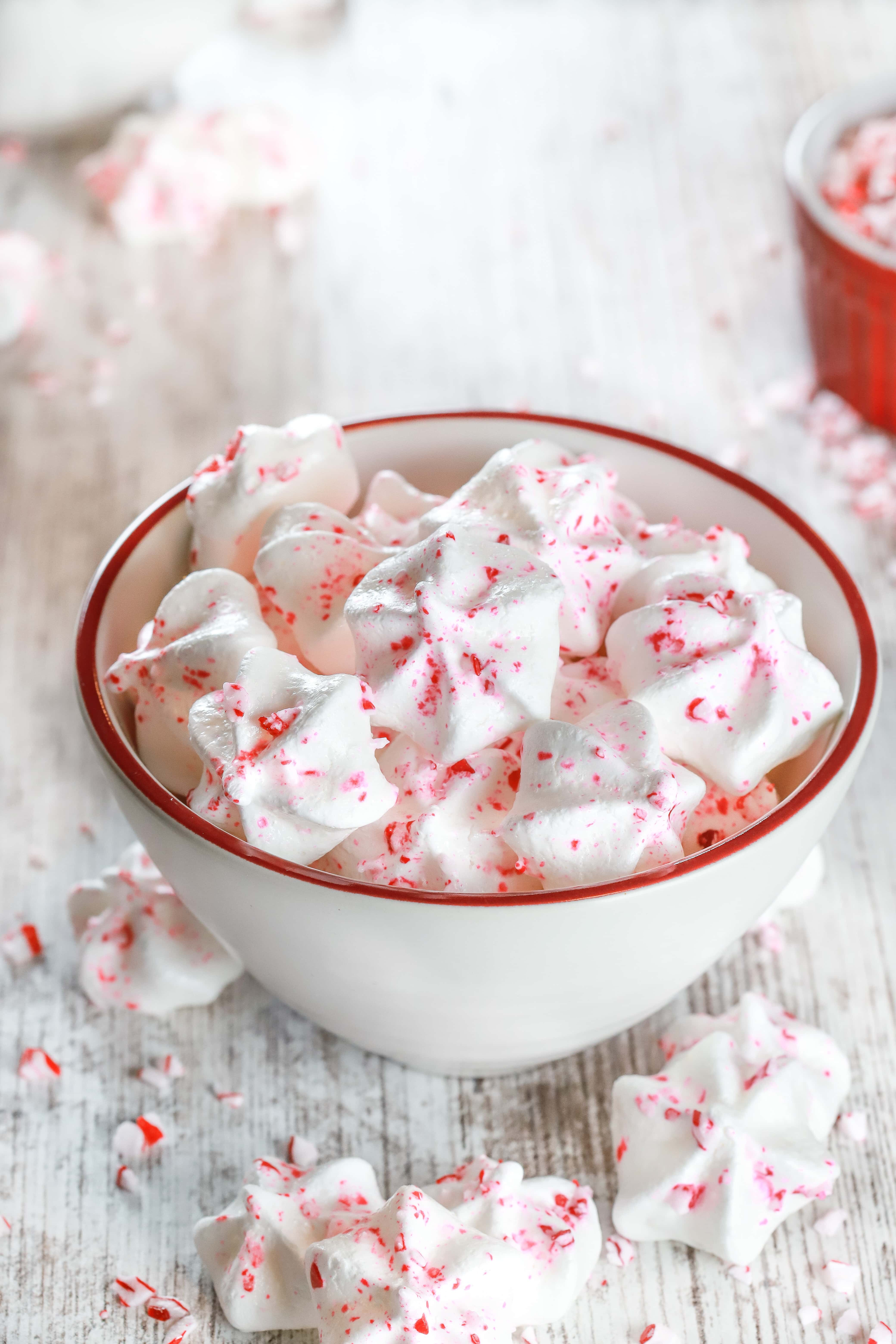 Small white bowl full of Mini Peppermint Meringue Cookies. Recipe from A Kitchen Addiction