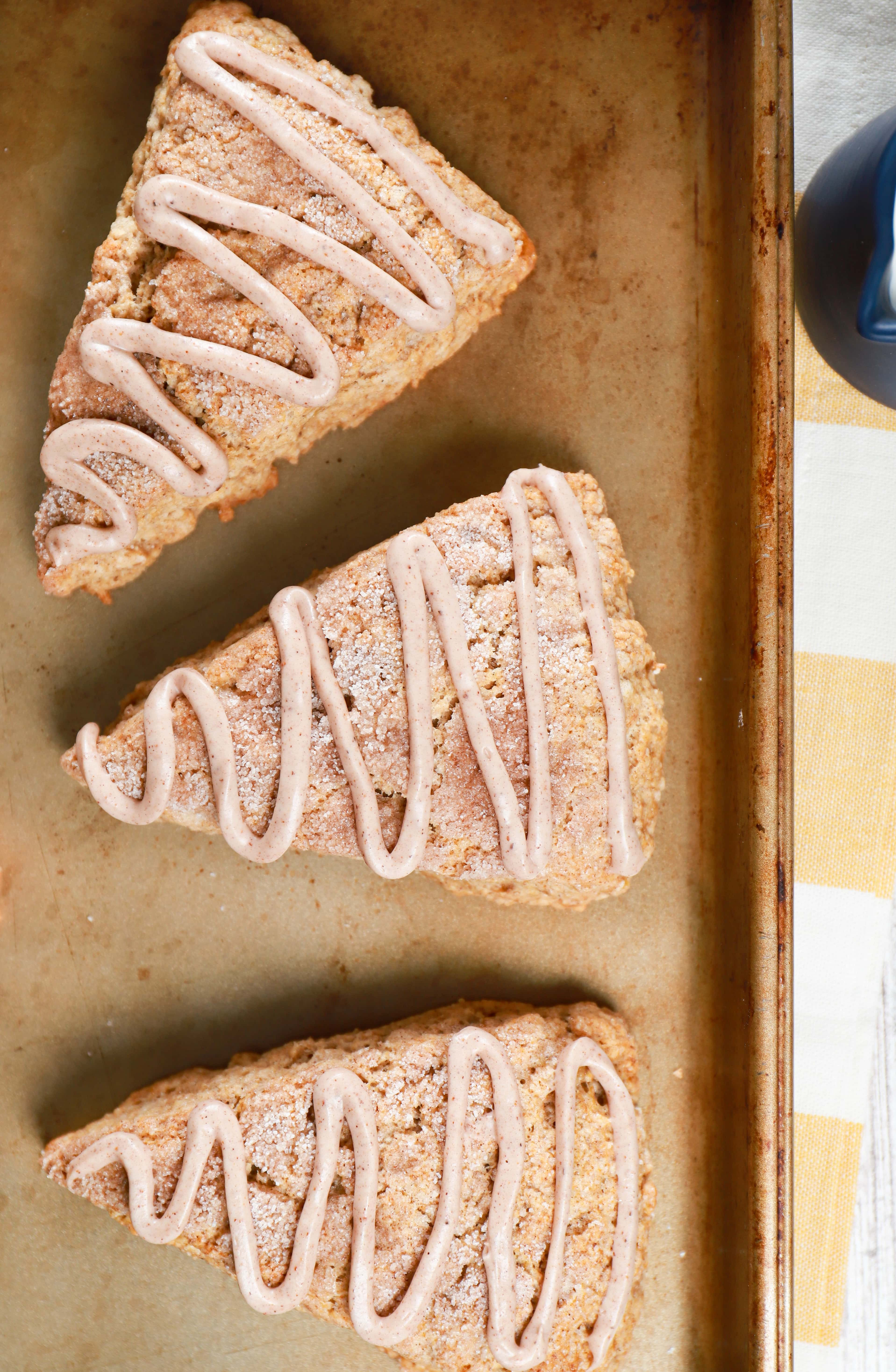 Overhead view of 3 snickerdoodle banana scones on a baking sheet. Recipe for scones from A Kitchen Addiction