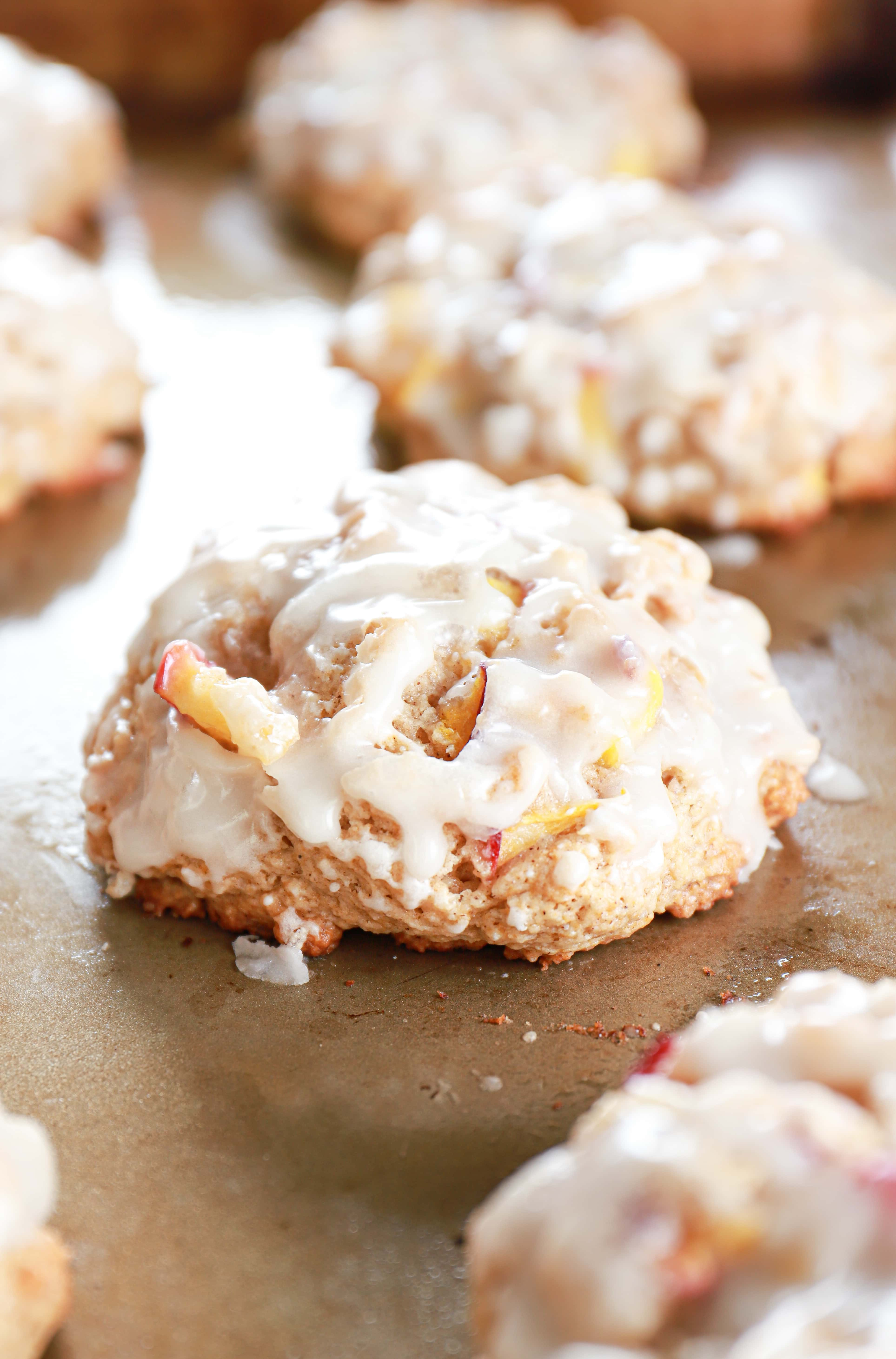 Baked peach fritters on a cookie sheet.