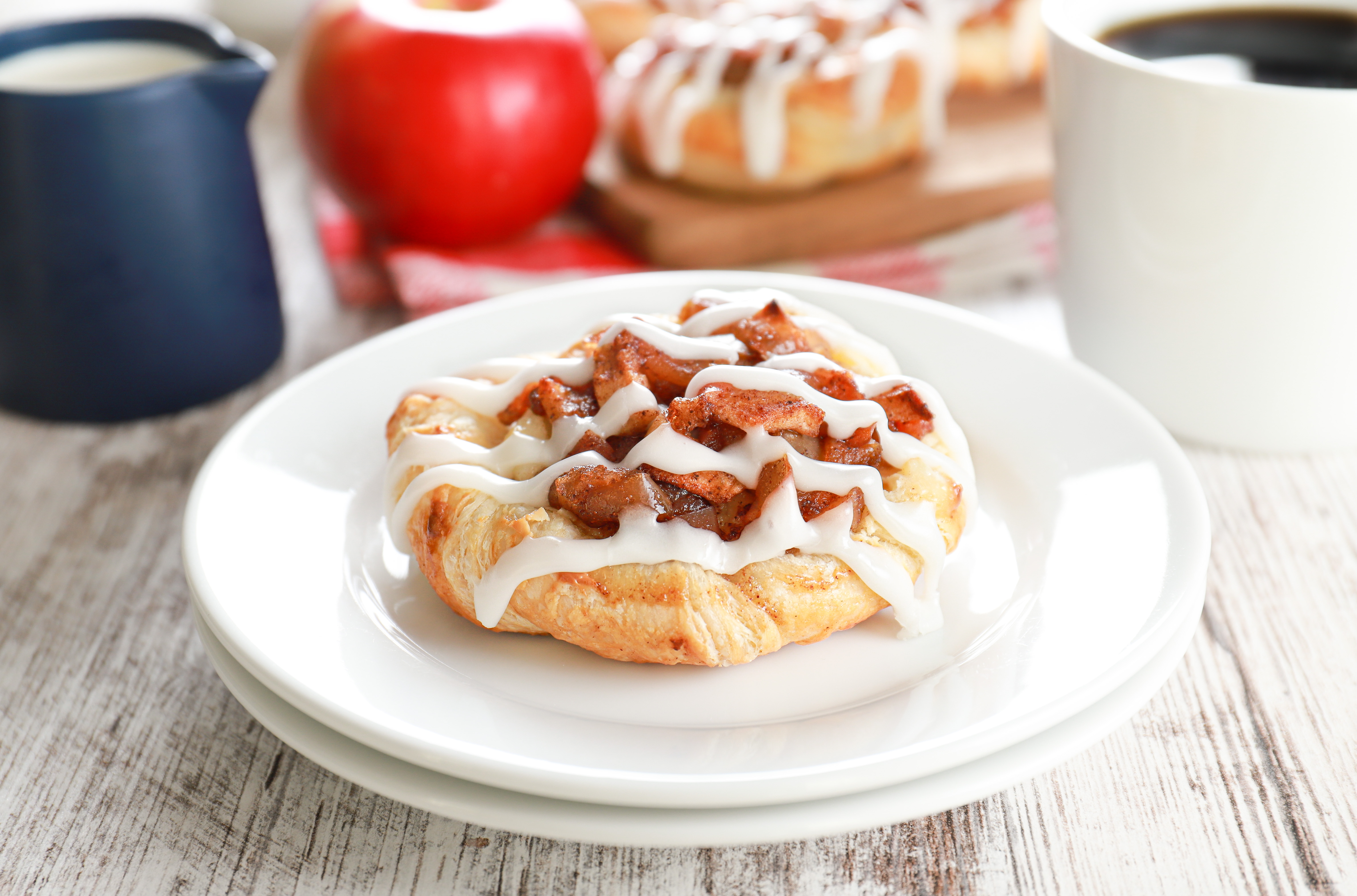 apple cream cheese danish on a small white plate