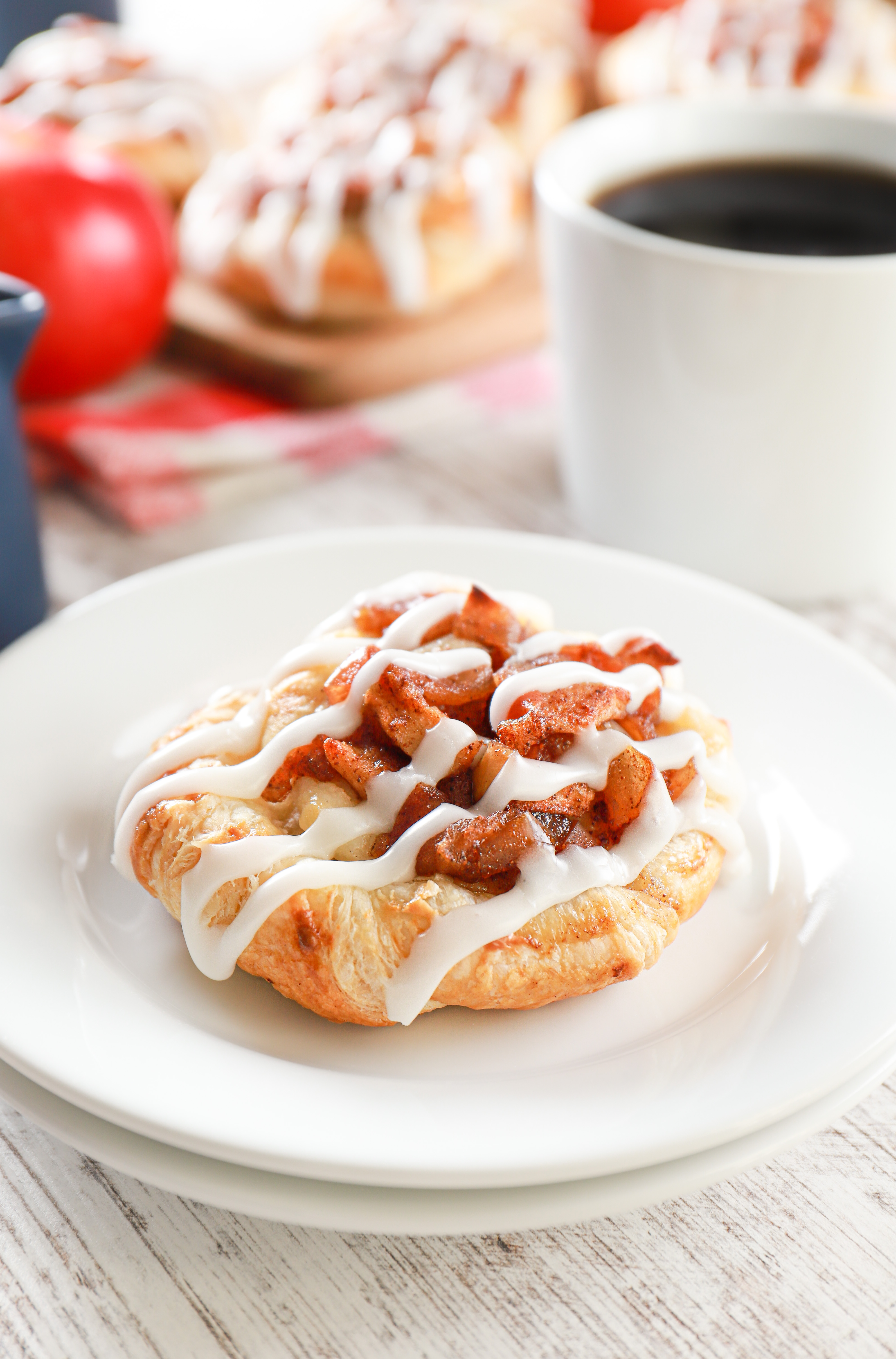 puff pastry apple cream cheese danish on a small white plate