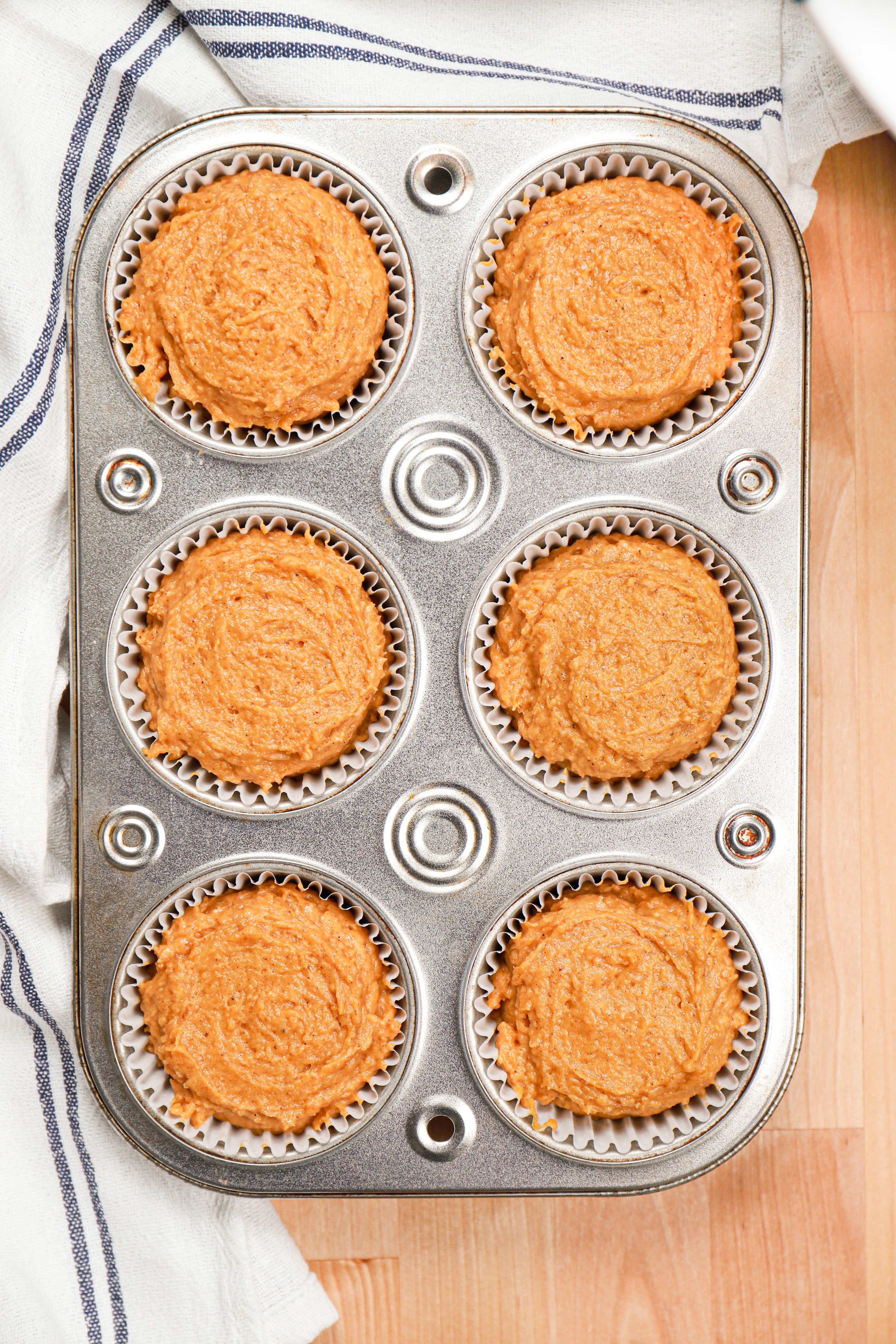 Pumpkin muffin batter in muffin tin